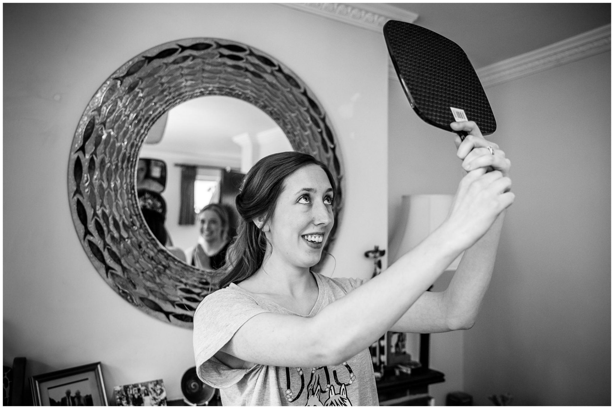 Timsbury Manor Festival Wedding bride examines hair in mirror