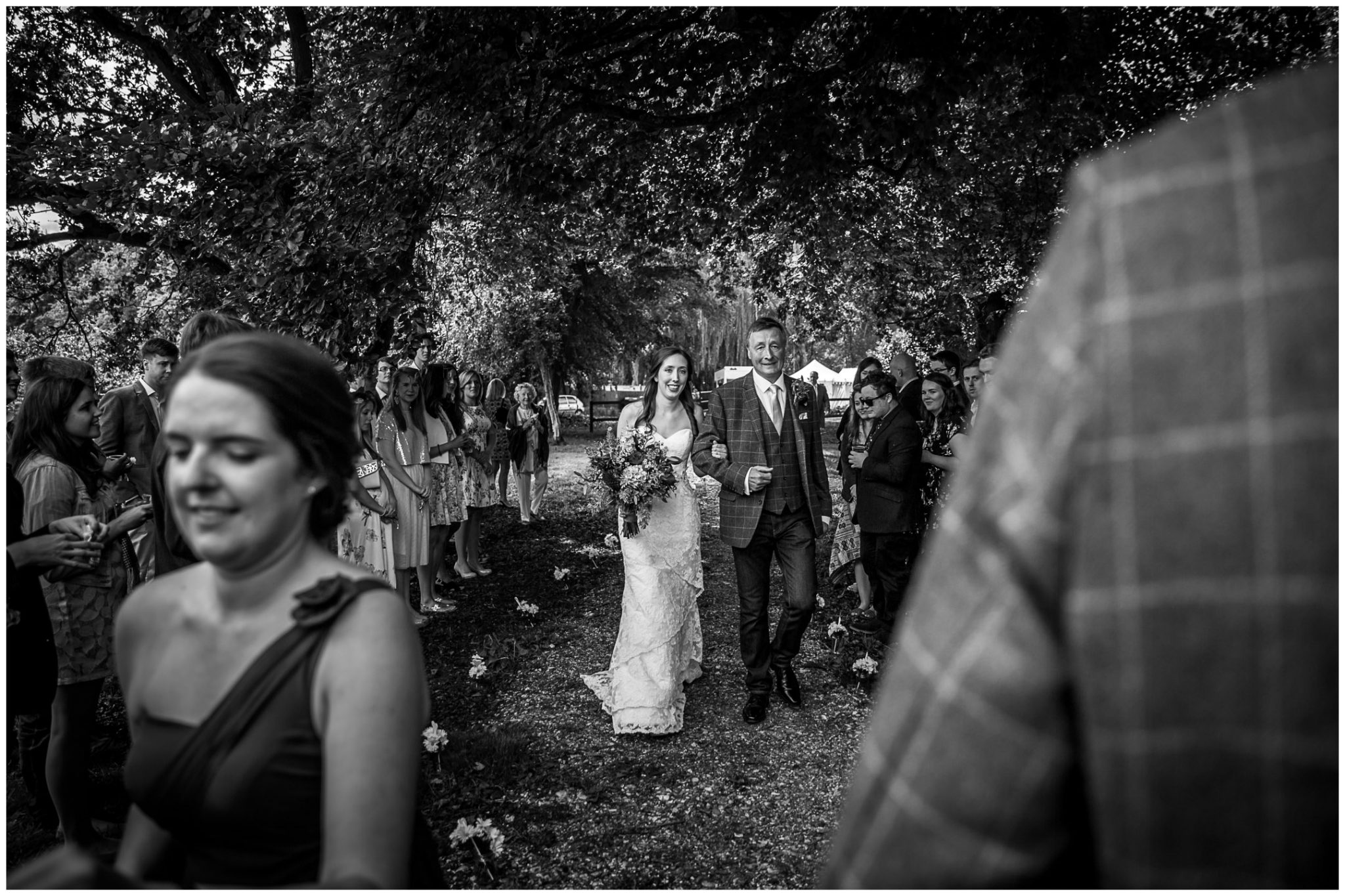 Timsbury Manor Festival Wedding bride walks down the aisle black and white