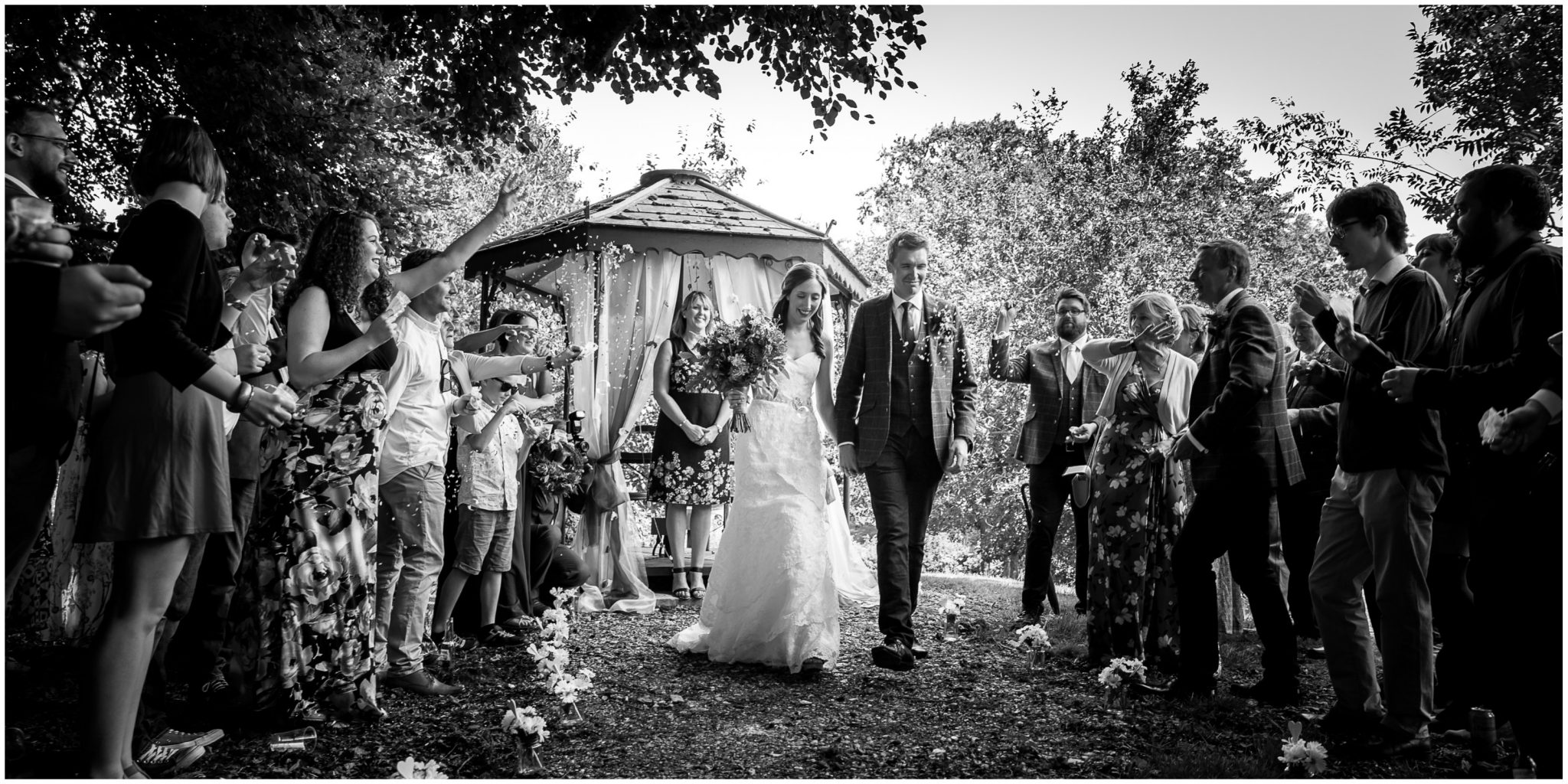 Timsbury Manor Festival Wedding couple walking down aisle together