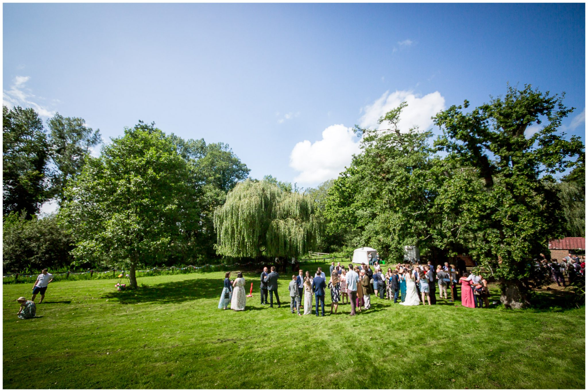 Timsbury Manor Festival Wedding guests enjoying the grounds of the estate