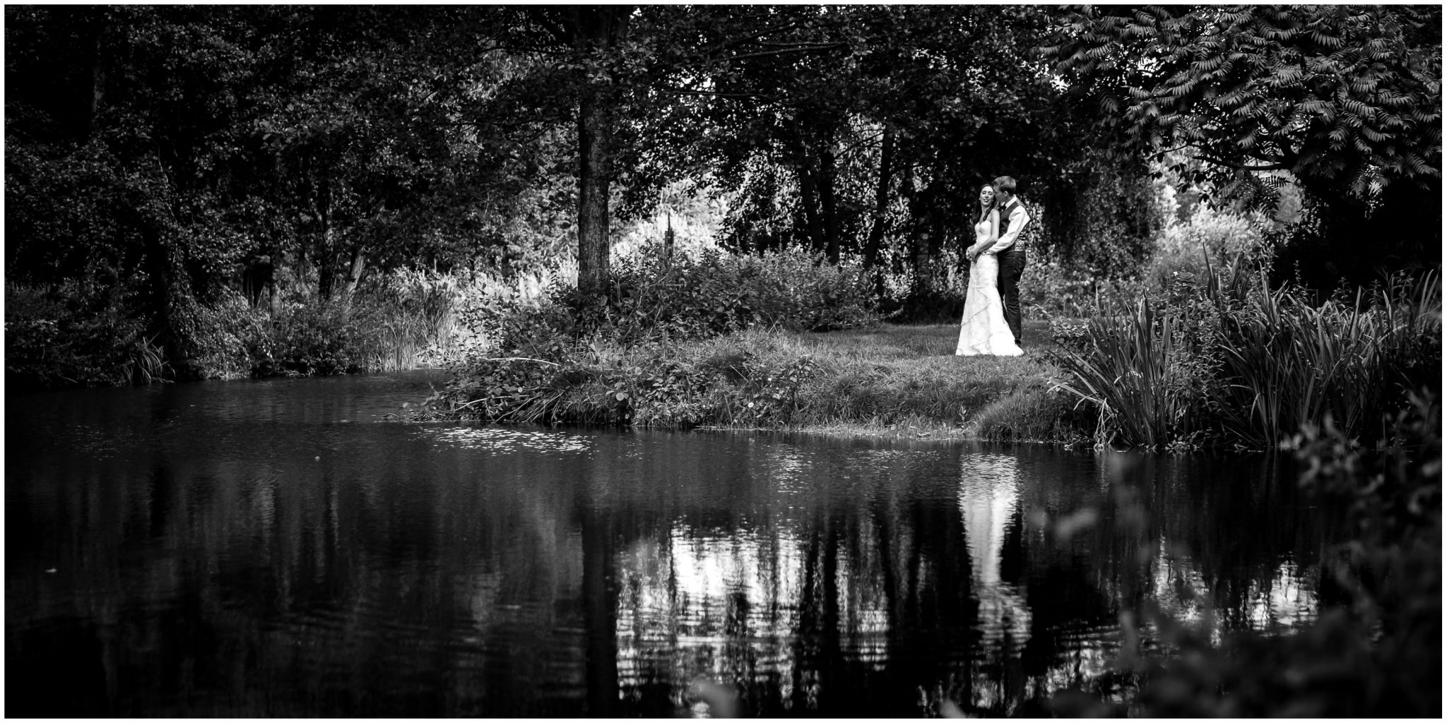 Timsbury Manor Festival Wedding black and white portrait of couple by lake