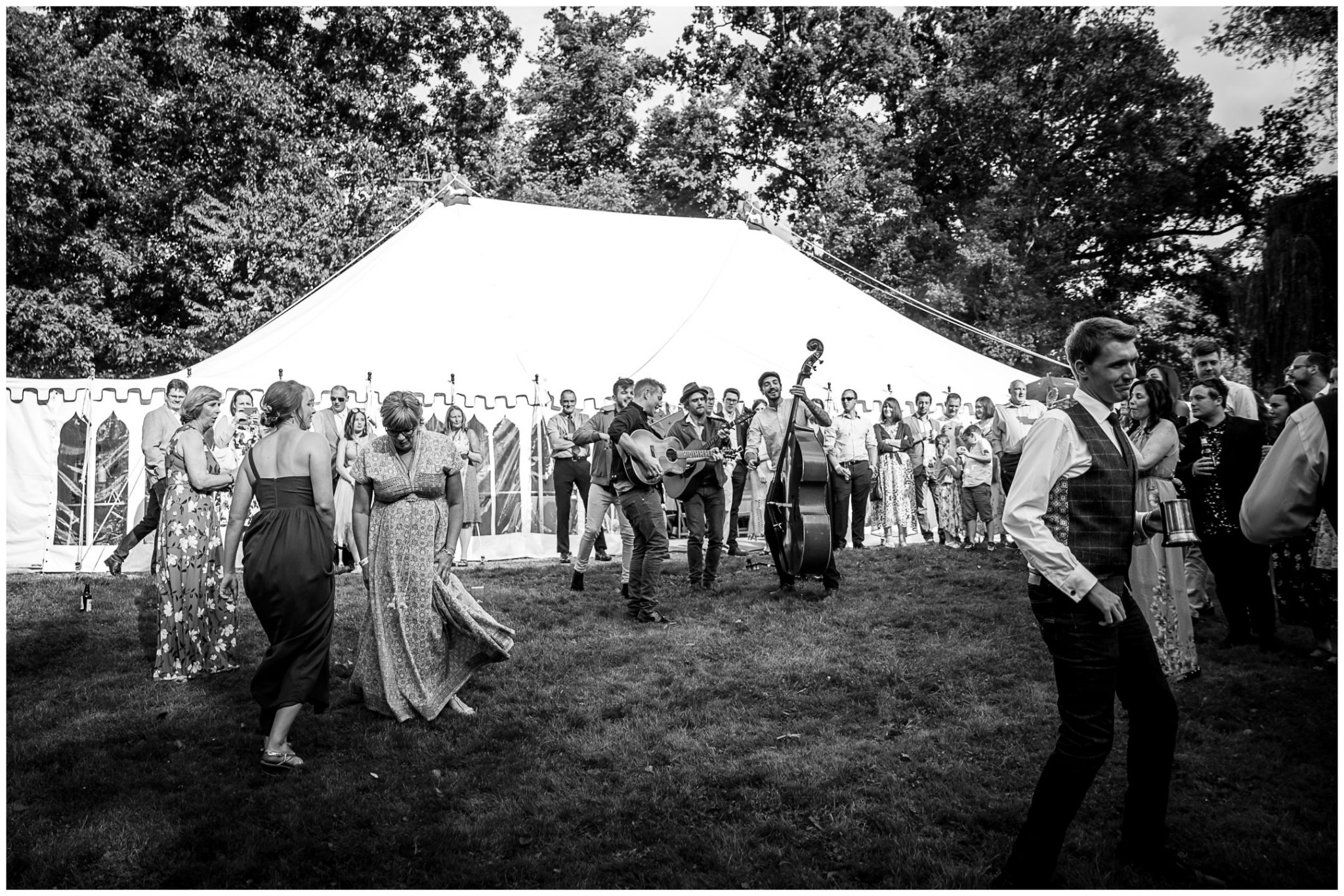 Timsbury Manor Festival Wedding band in front of marquee