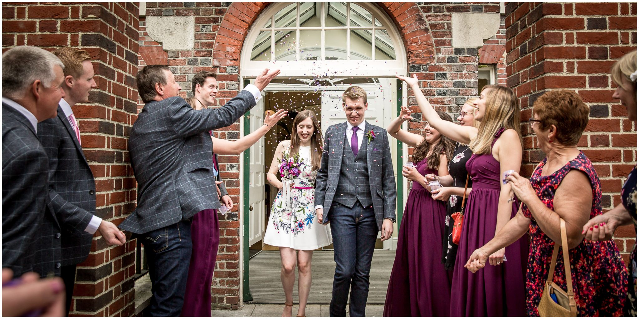 Portsmouth Registry Office wedding confetti as bride and groom exit building