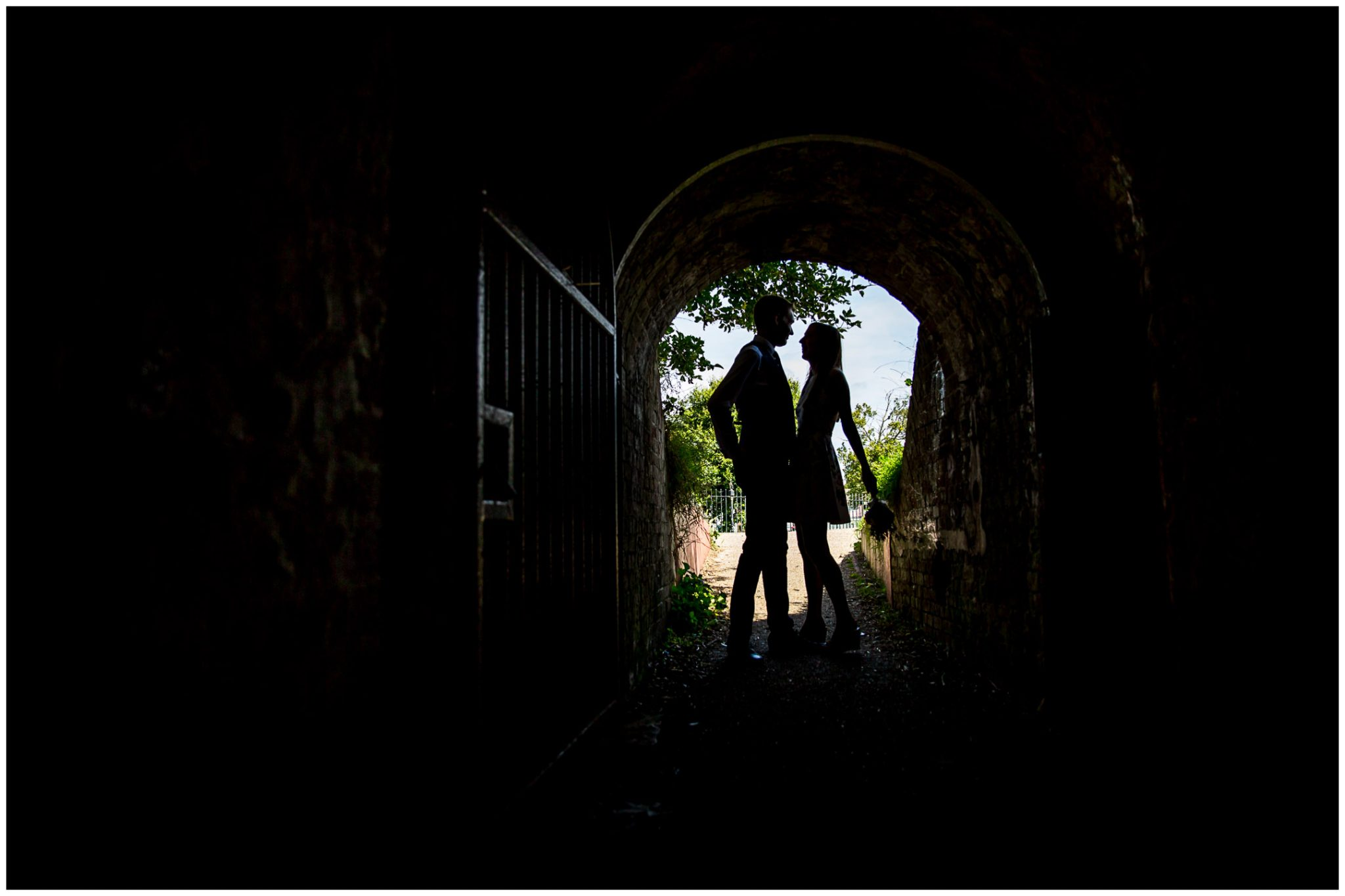 Portsmouth Registry Office wedding silhouette of bride and groom in tunnel