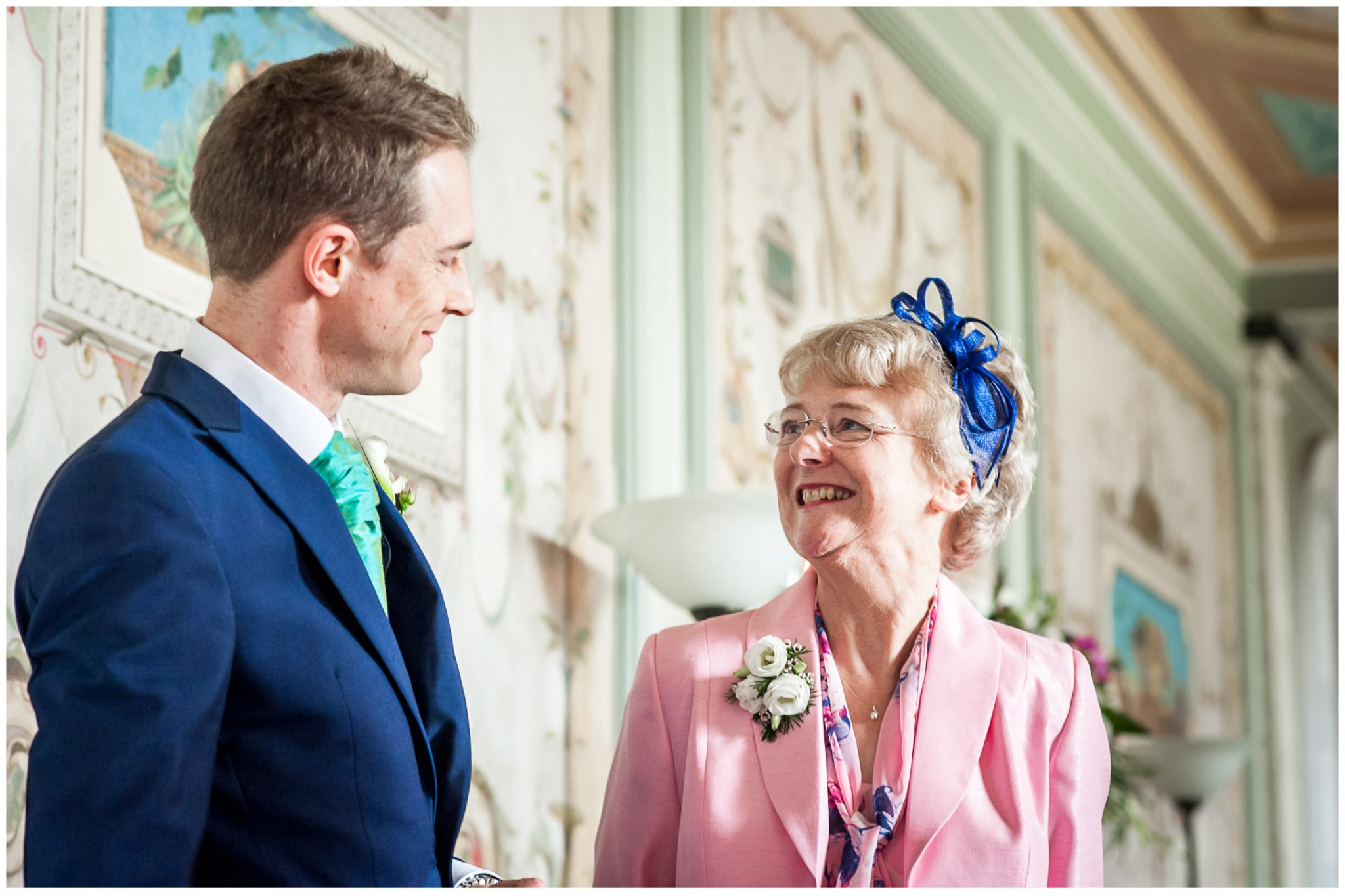 Avington Park wedding photography groom and mother in hall