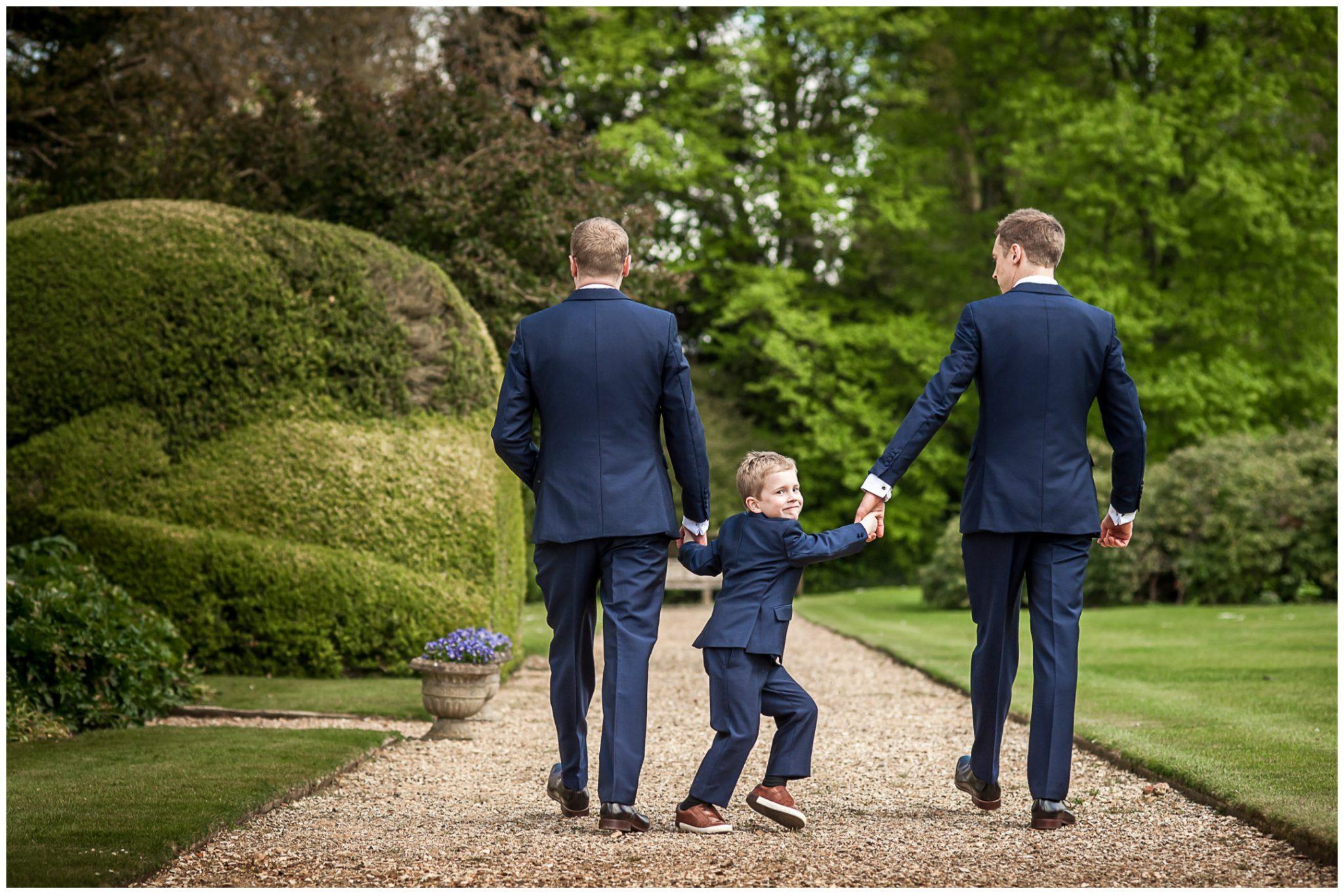 Avington Park wedding photography groomsmen walking in grounds