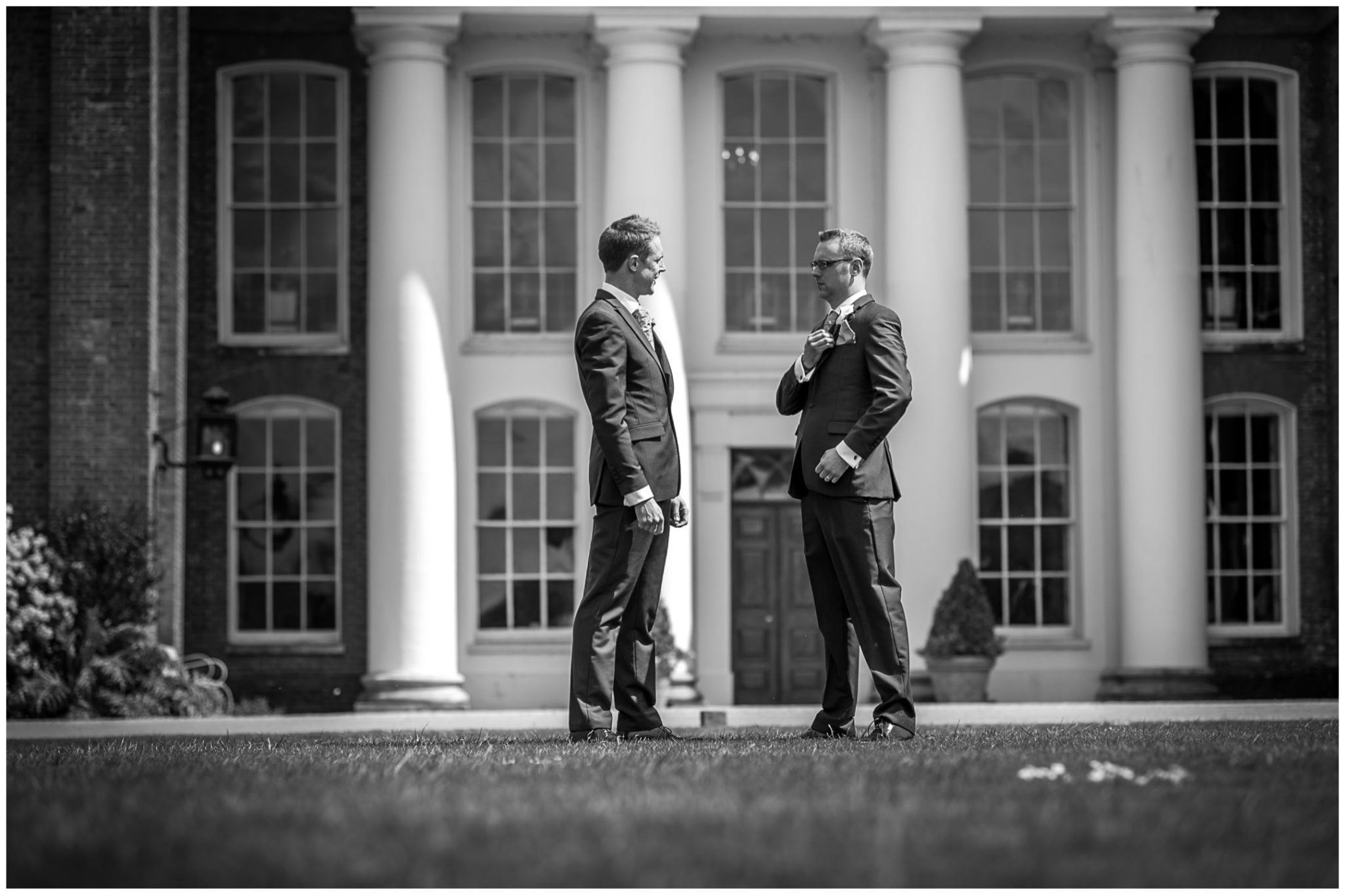 Avington Park wedding photography groom with best man in front of house