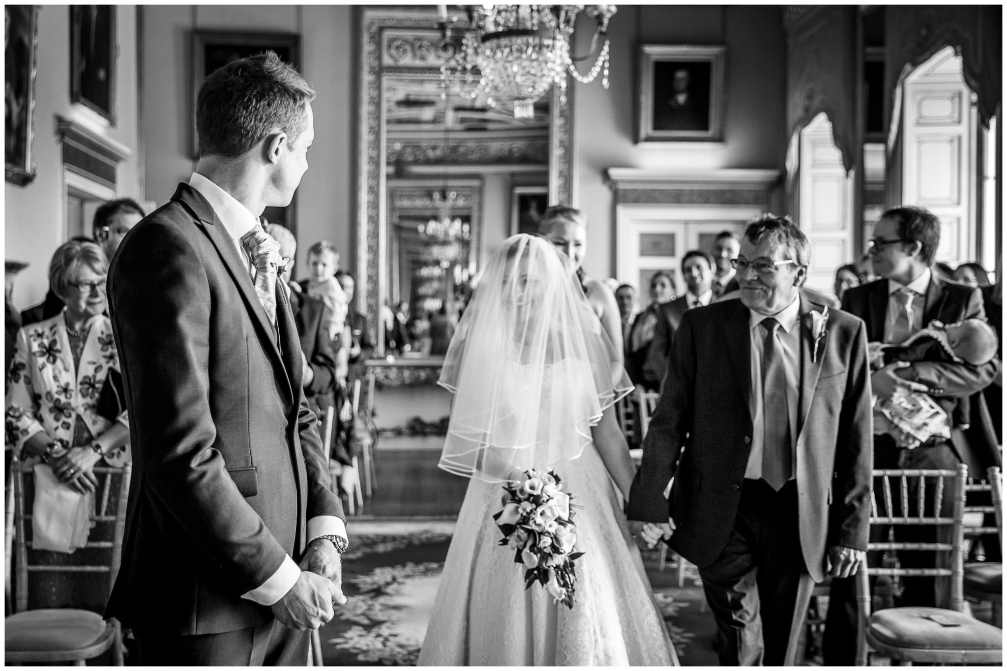 Avington Park wedding photography bride arrives at the front of the ceremony room