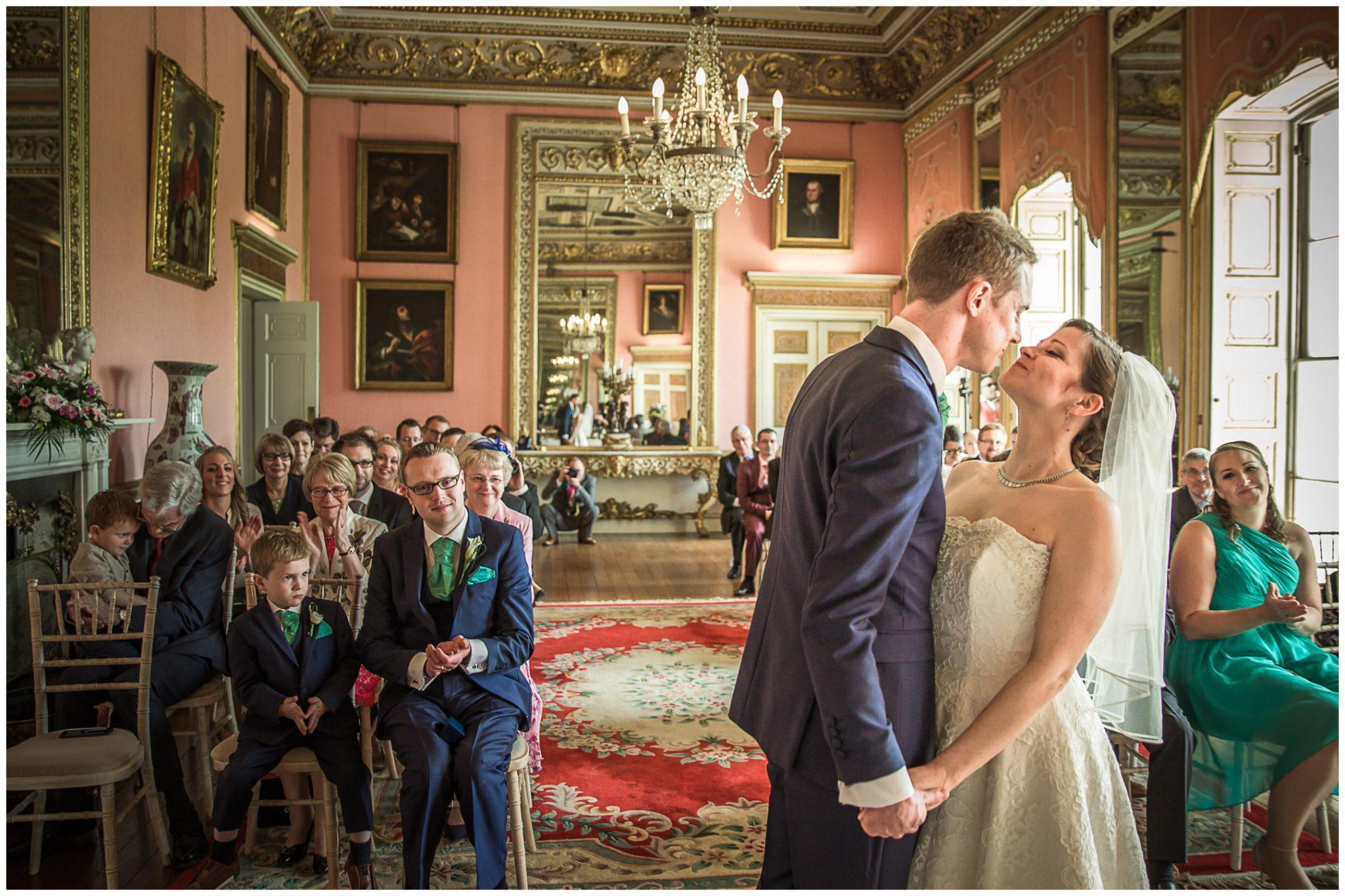Avington Park wedding photography first kiss