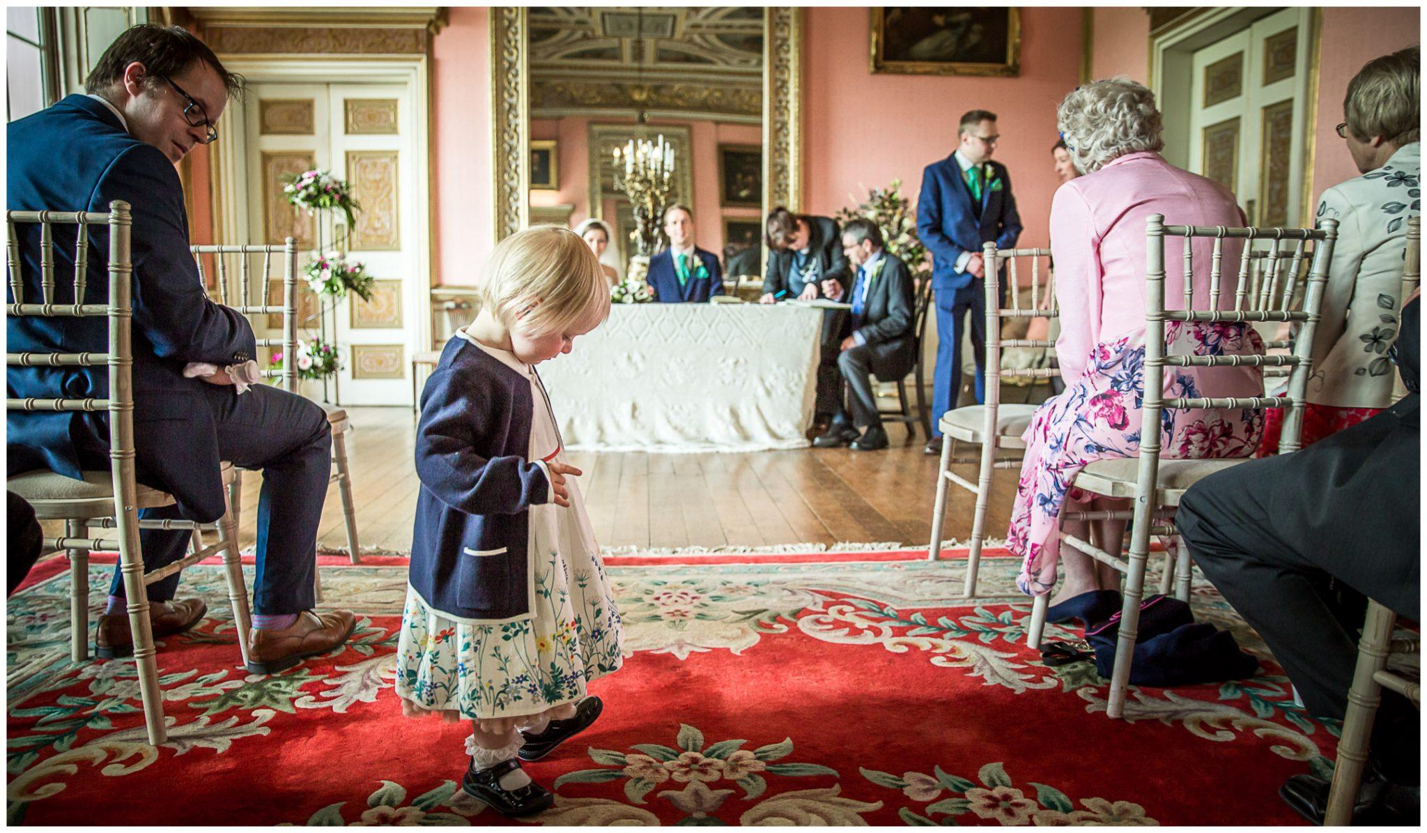 Avington Park wedding photography signing of register in ballroom