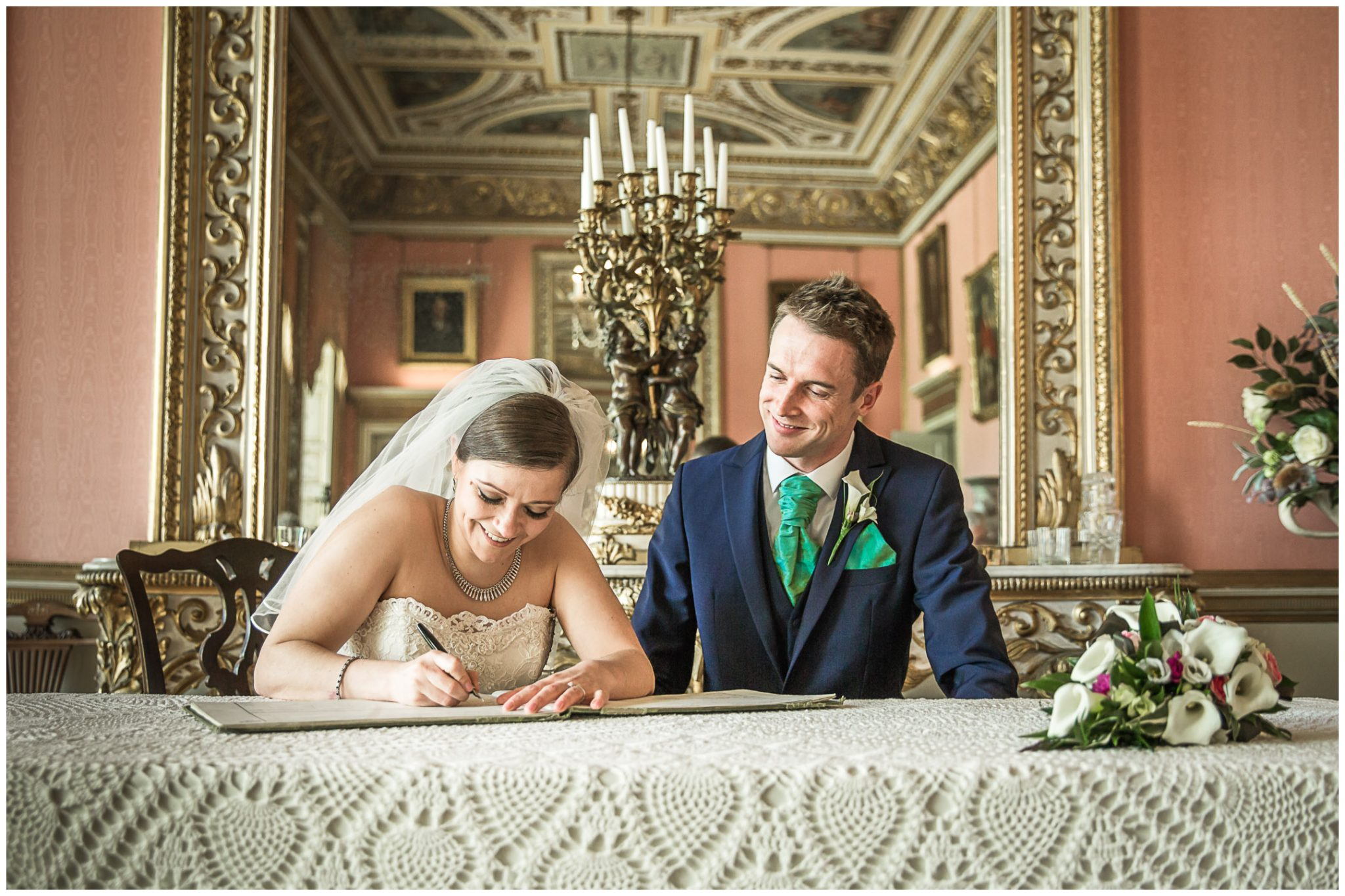 Avington Park wedding photography couple sign the marriage register