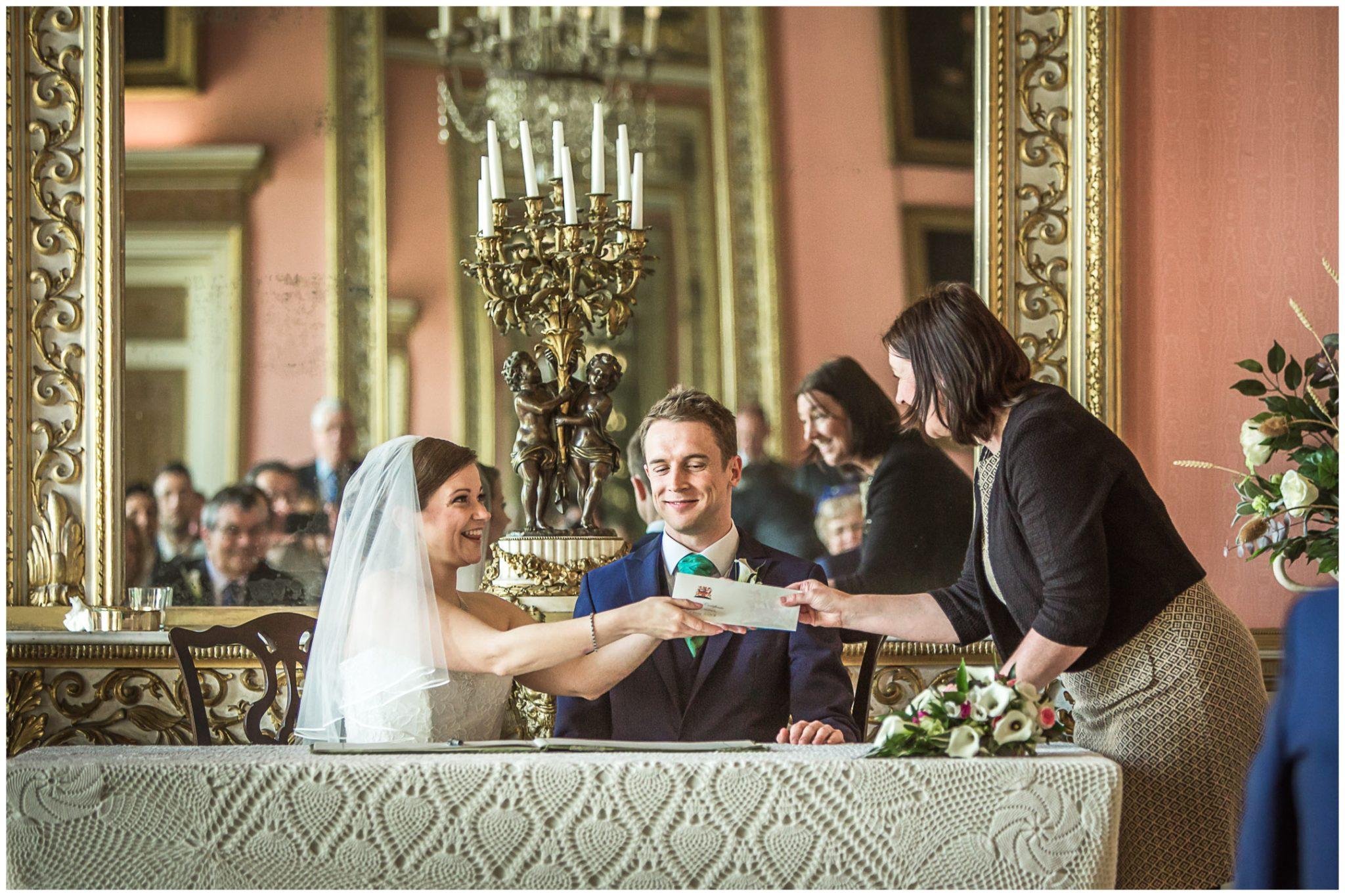 Avington Park wedding photography bride receives marriage certificate