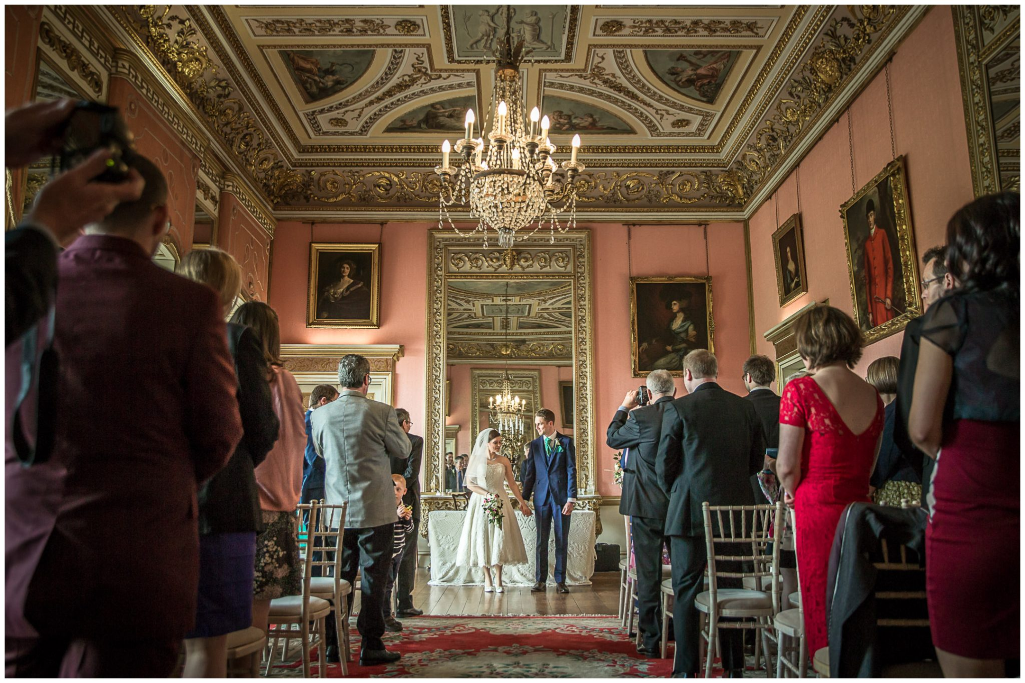 Avington Park wedding photography couple in ballroom before walking down aisle