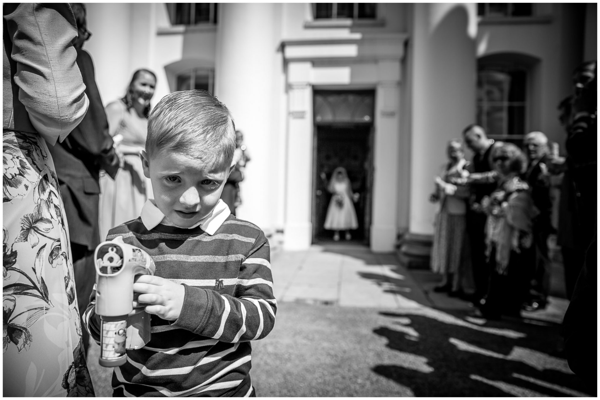 Avington Park wedding photography young guest with bubble machine
