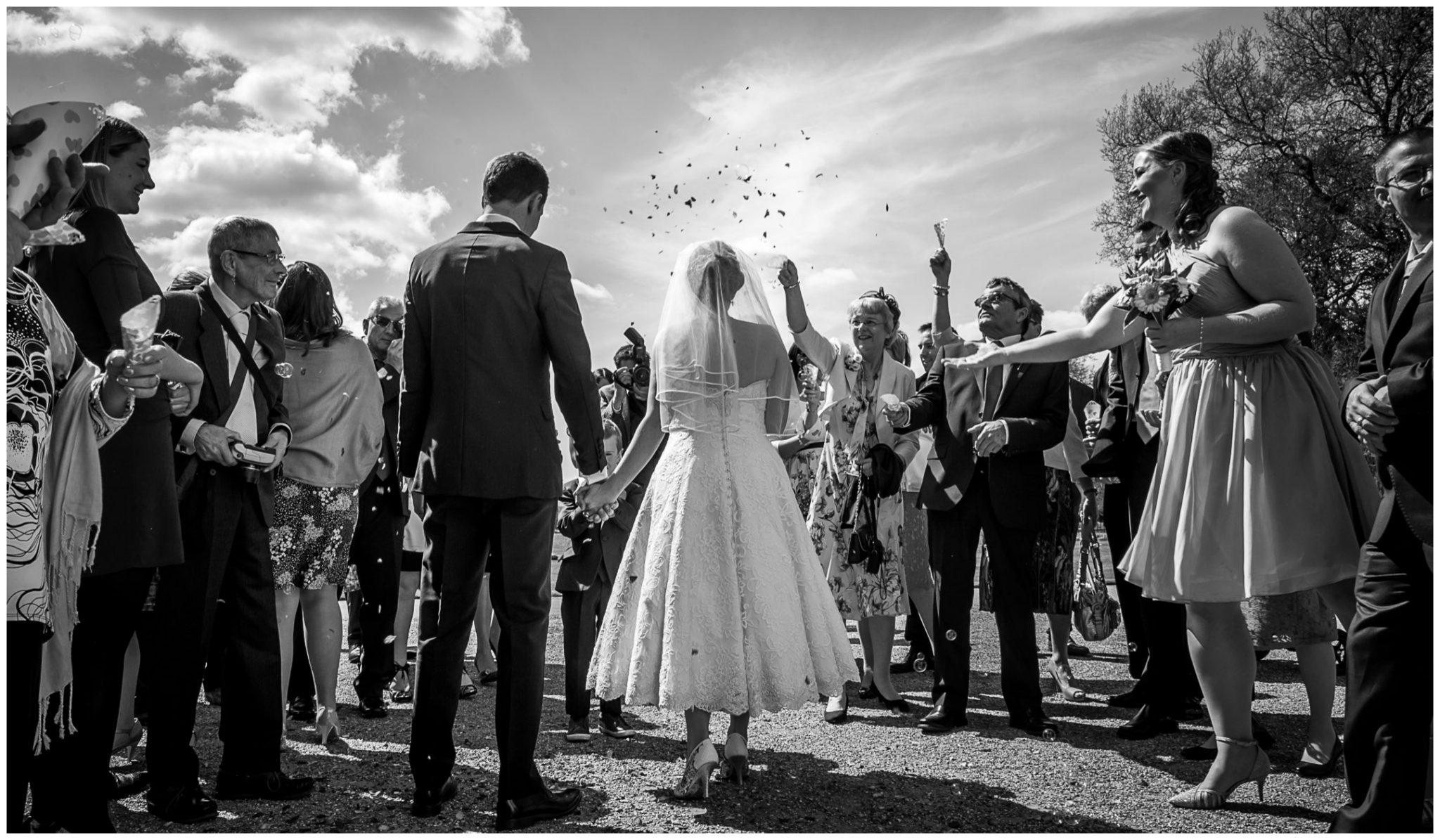 Avington Park wedding photography guests throw confetti