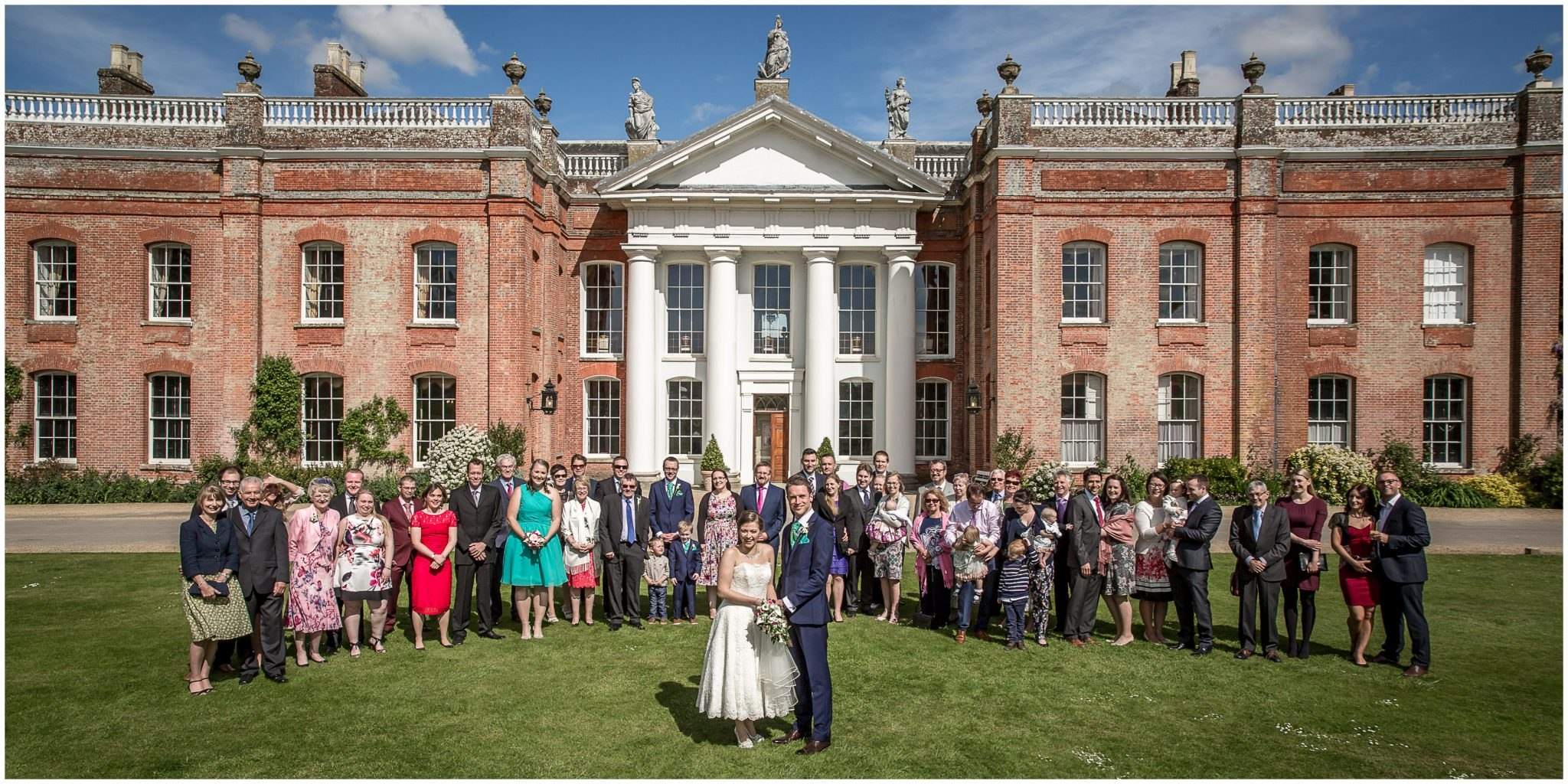 Avington Park wedding photography group photo of guests in front of house