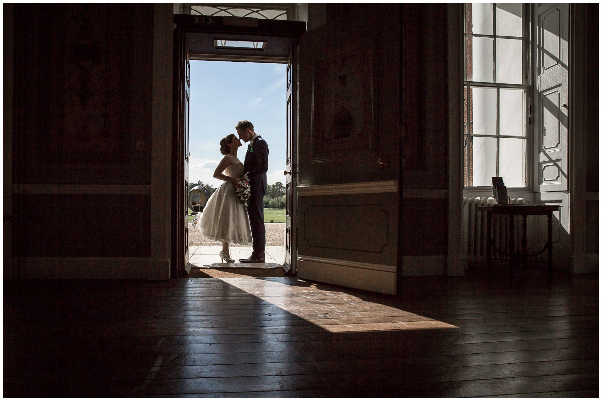Avington Park wedding photography couple framed by front door