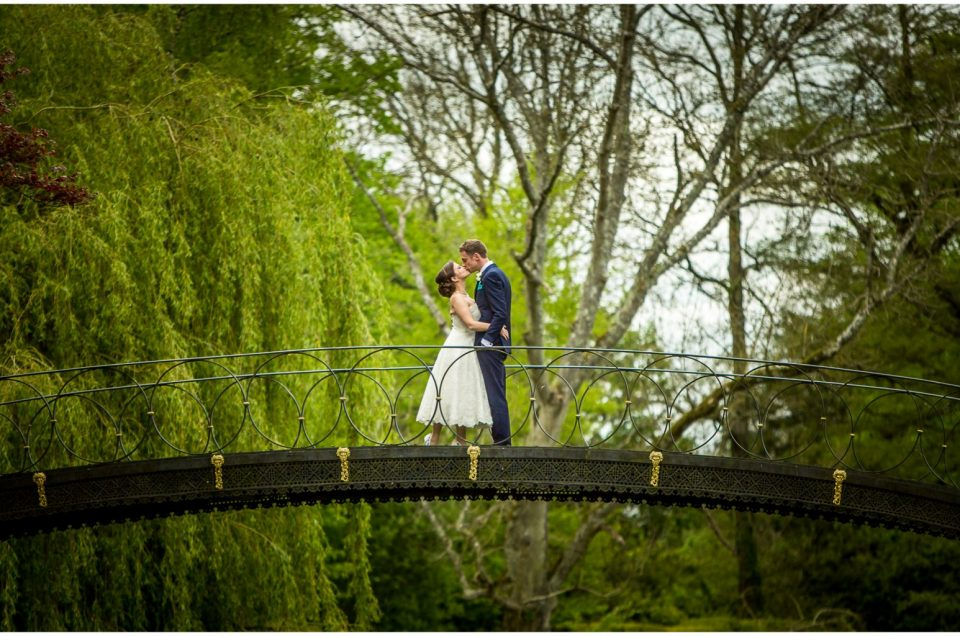 Avington Park wedding photography couple on iron bridge
