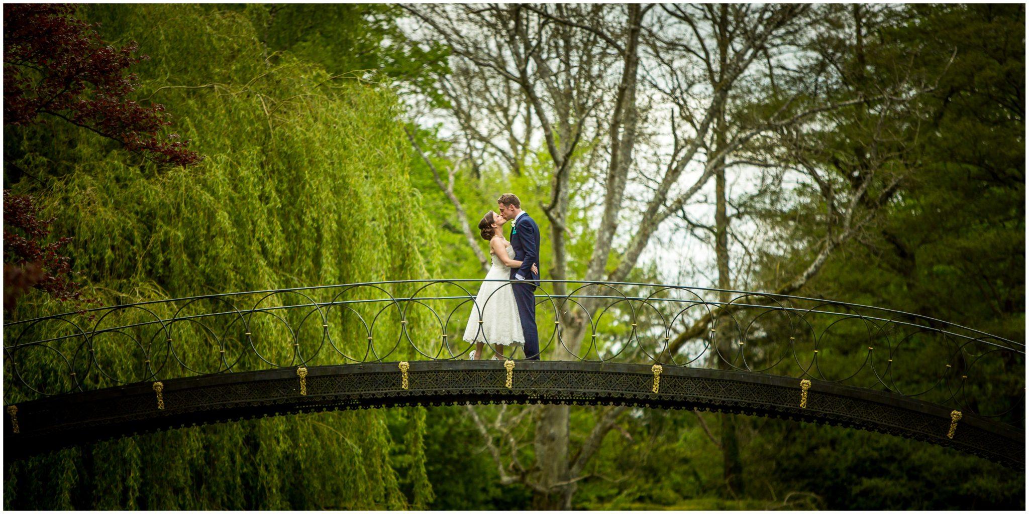 Avington Park wedding photography couple on iron bridge