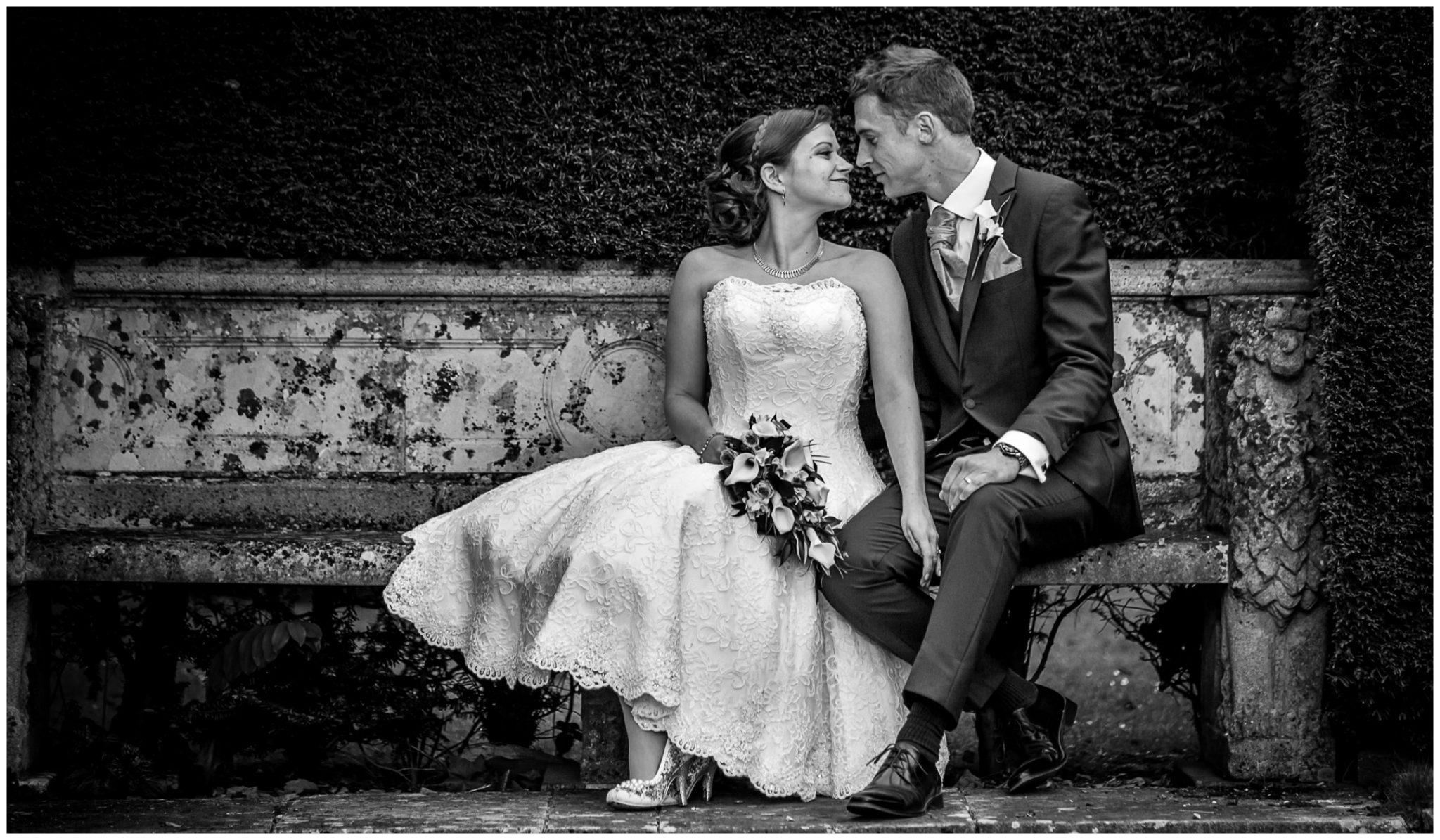 Avington Park wedding photography couple on stone bench