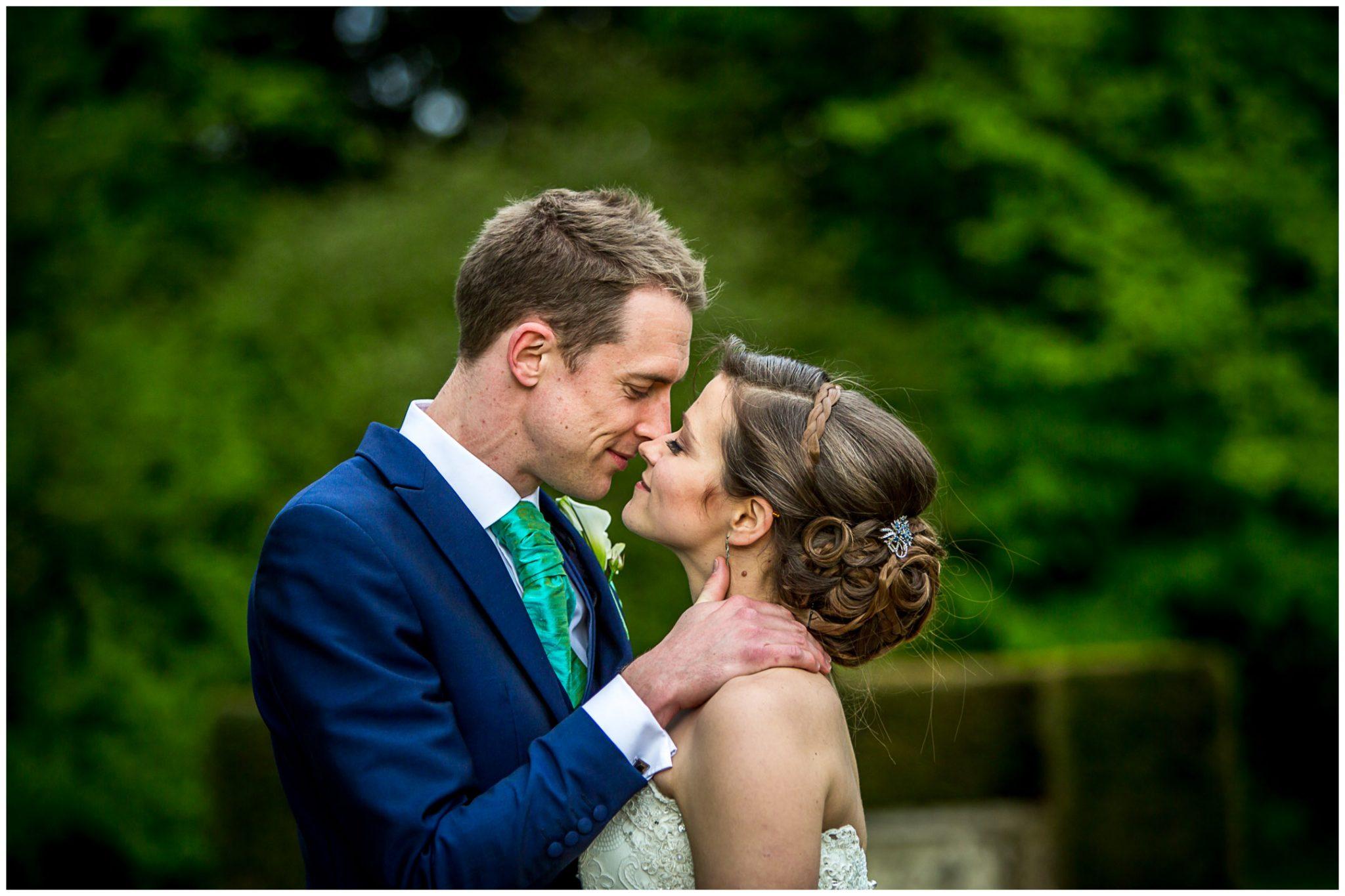 Avington Park wedding photography couple kiss