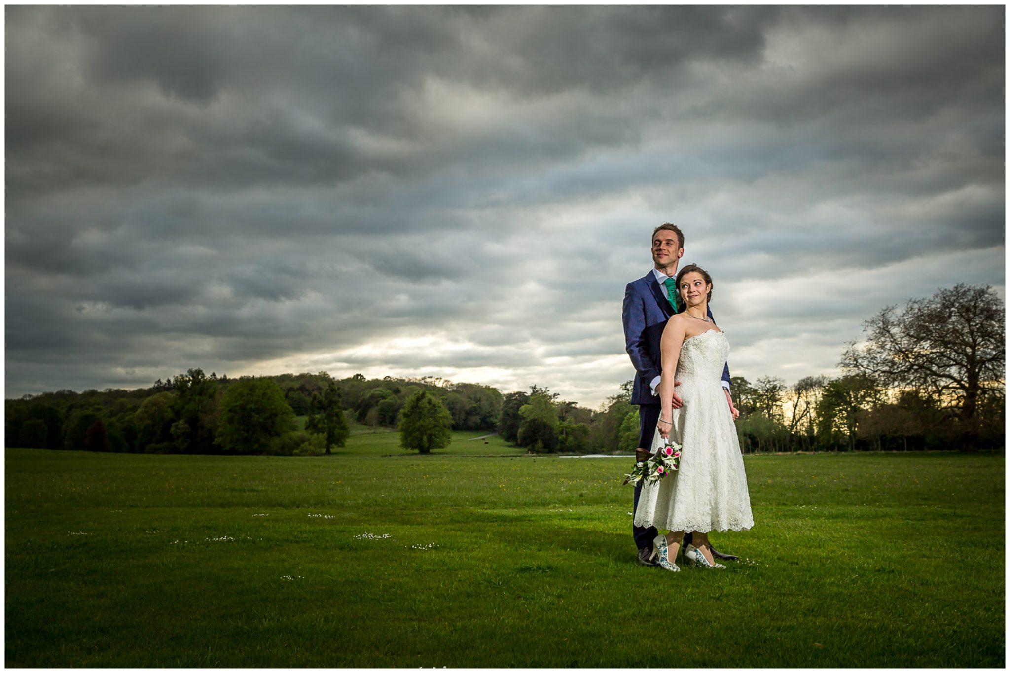 Avington Park wedding photography bride and groom in gardens
