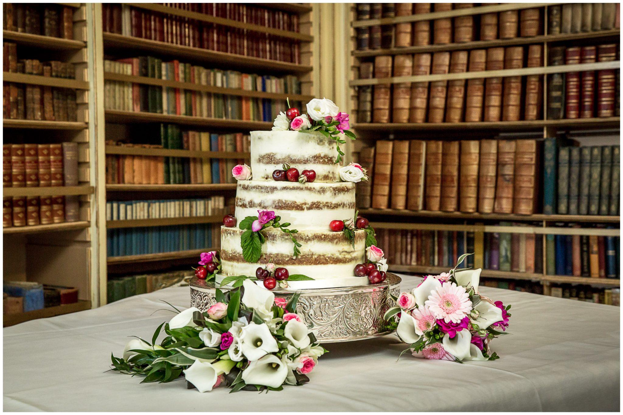 Avington Park wedding photography wedding cake in library