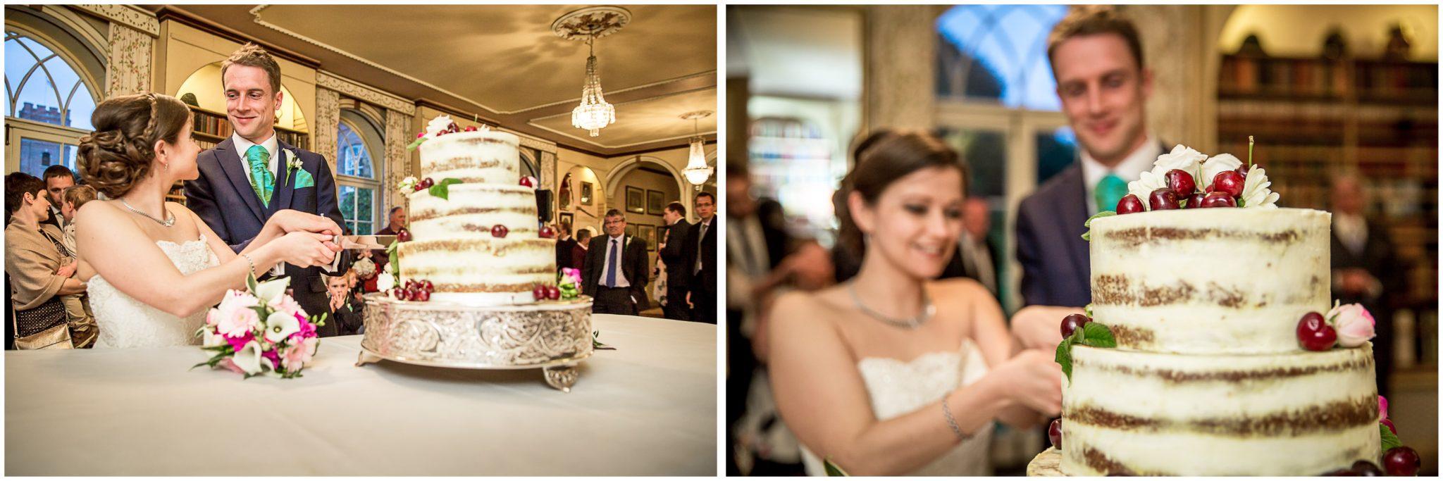 Avington Park wedding photography cutting the cake