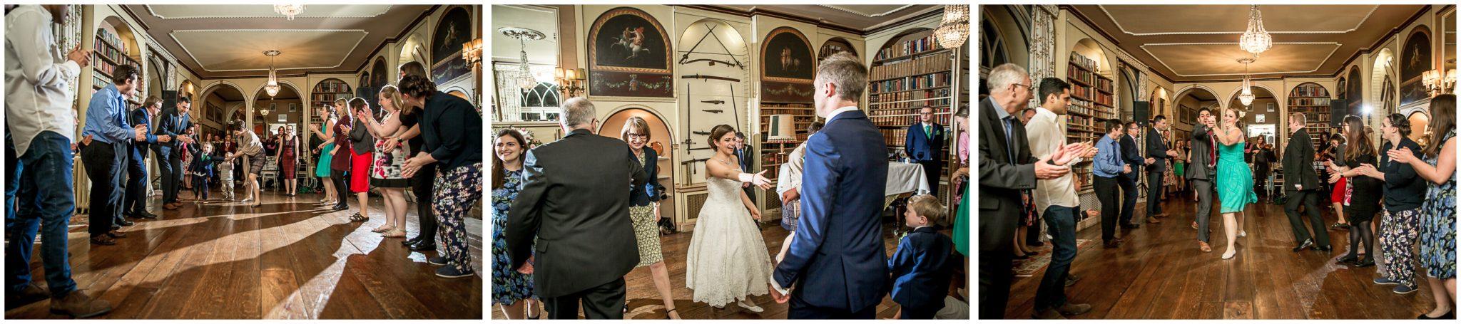 Avington Park wedding photography ceilidh in library