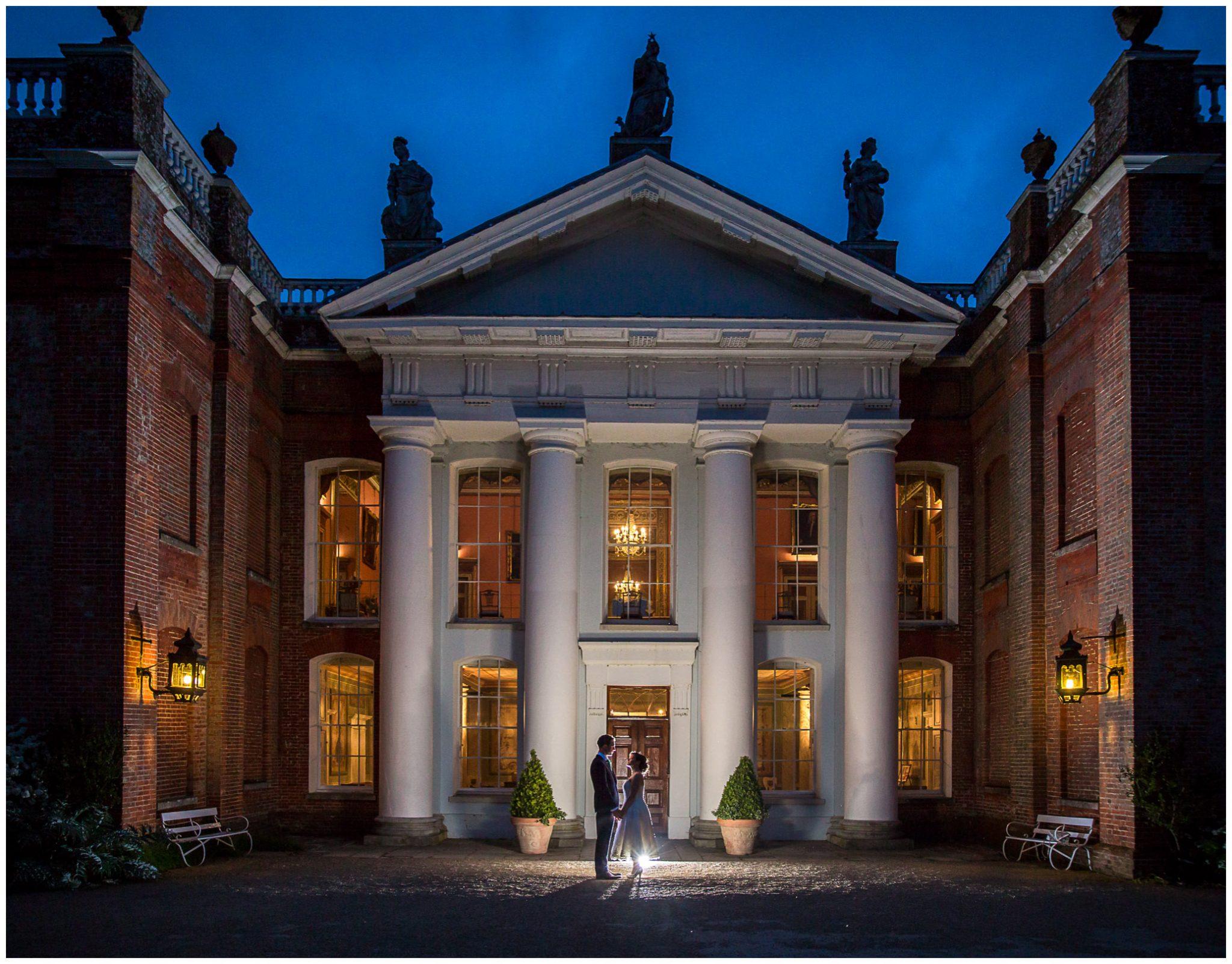 Avington Park wedding photography low light portrait flash lit front of house