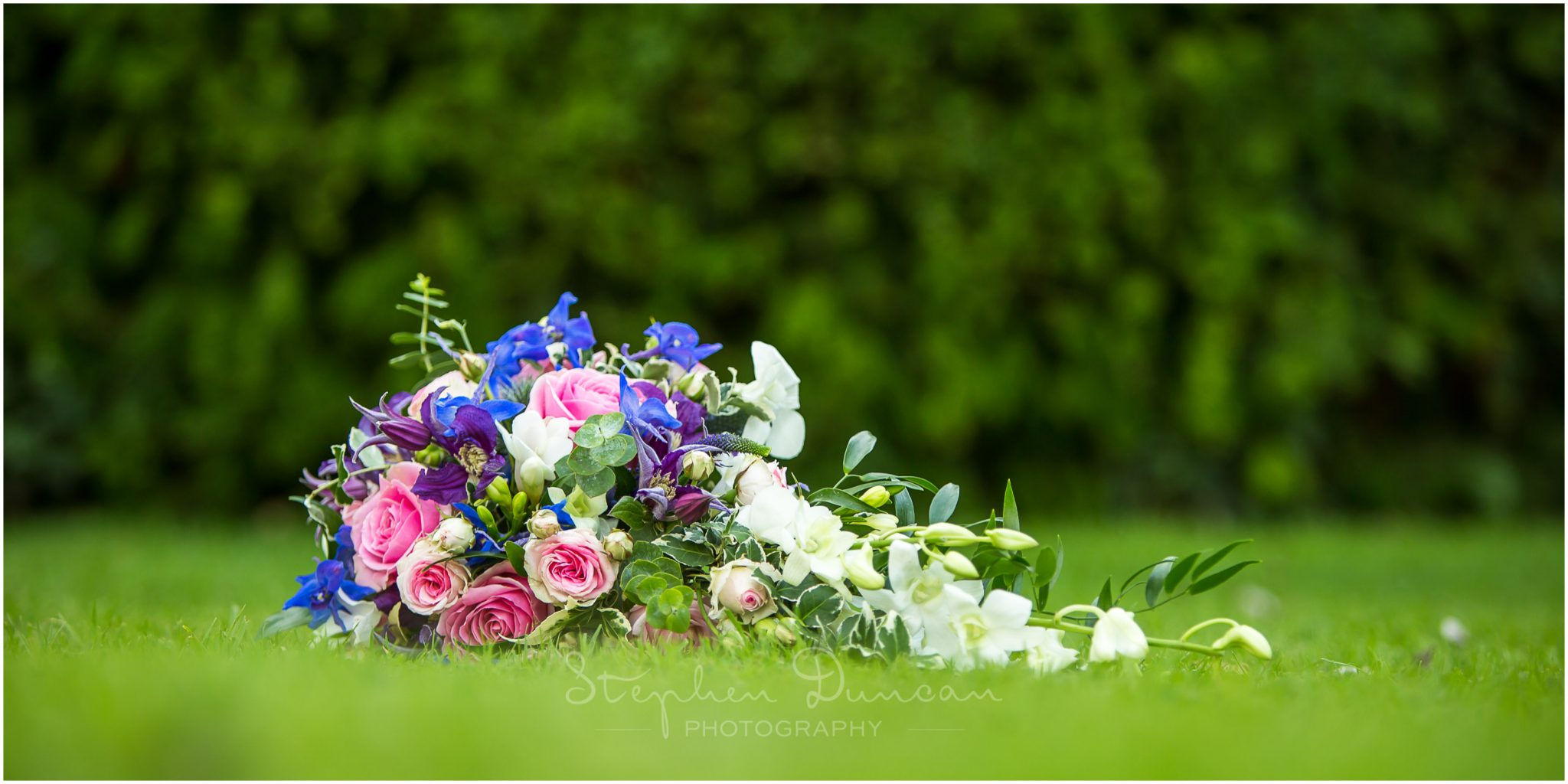 Lymington wedding photography bouquet on lawn