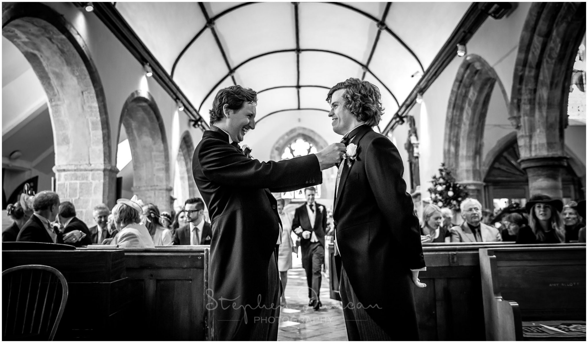 Lymington wedding photography groom and best man waiting in church