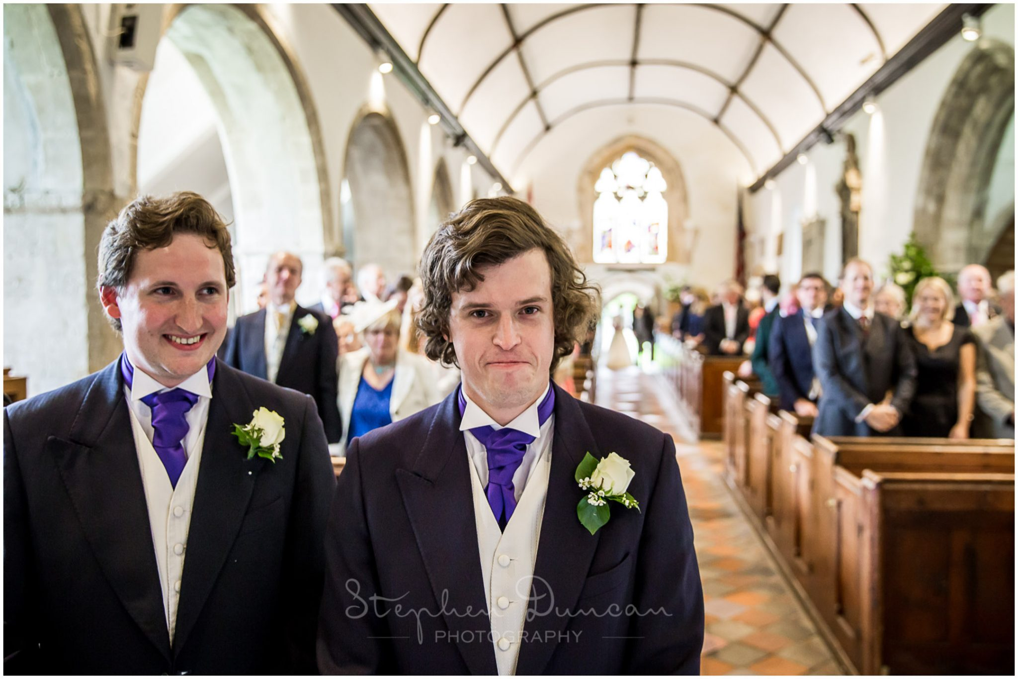 Lymington wedding photography groom as bride arrives