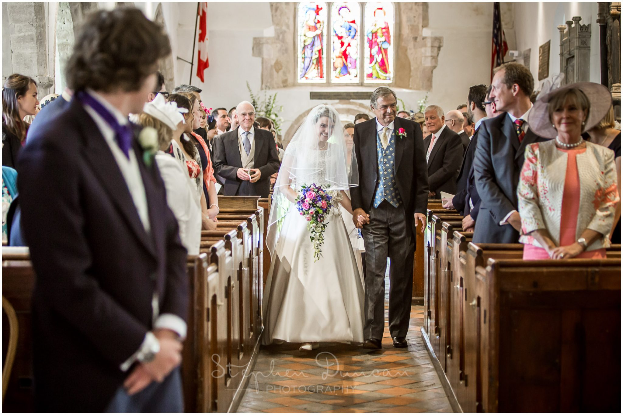Lymington wedding photography bride walking down aisle of Boldre church