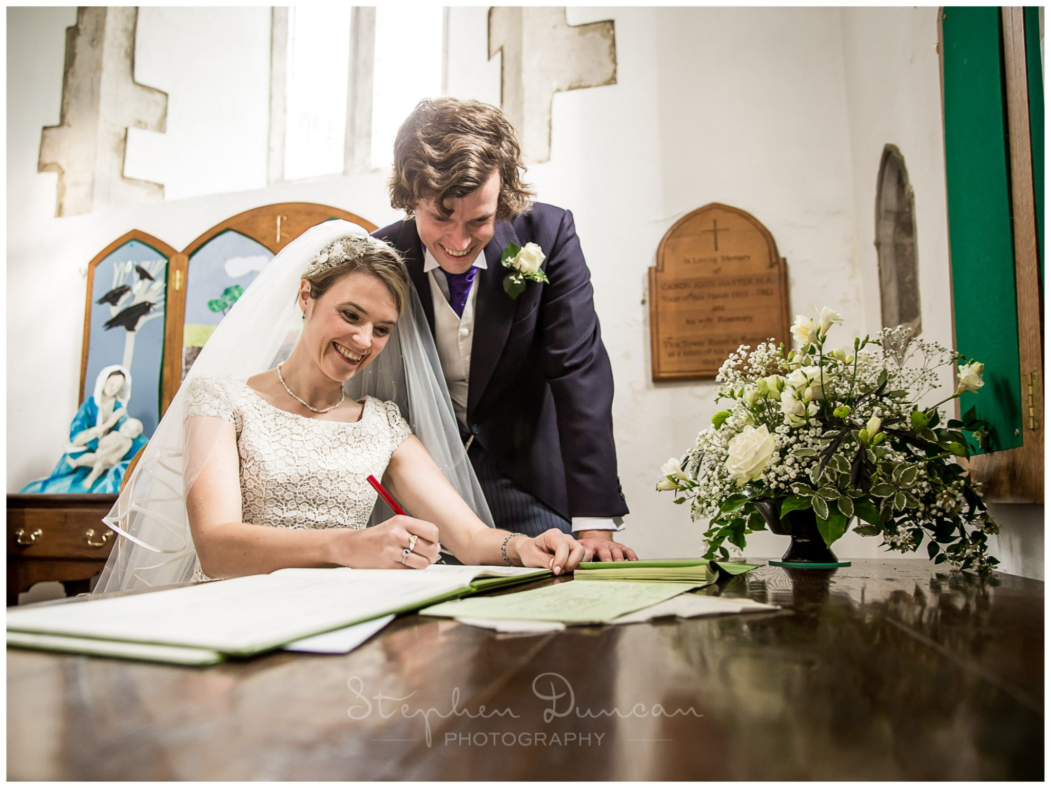 Lymington wedding photography couple sign the register