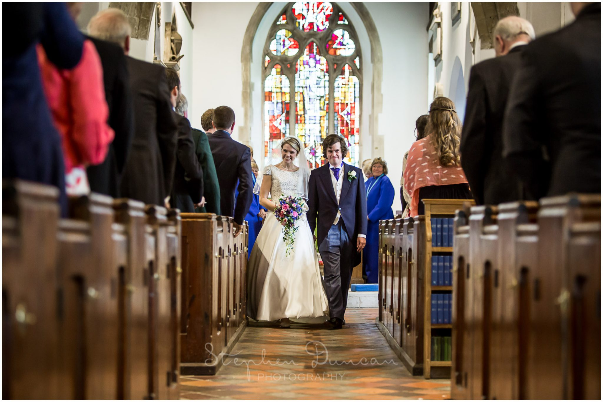 Lymington wedding photography bride and groom walk down aisle