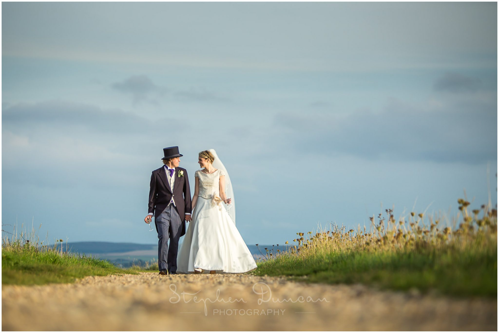 Lymington wedding photography couple walk in sunshine