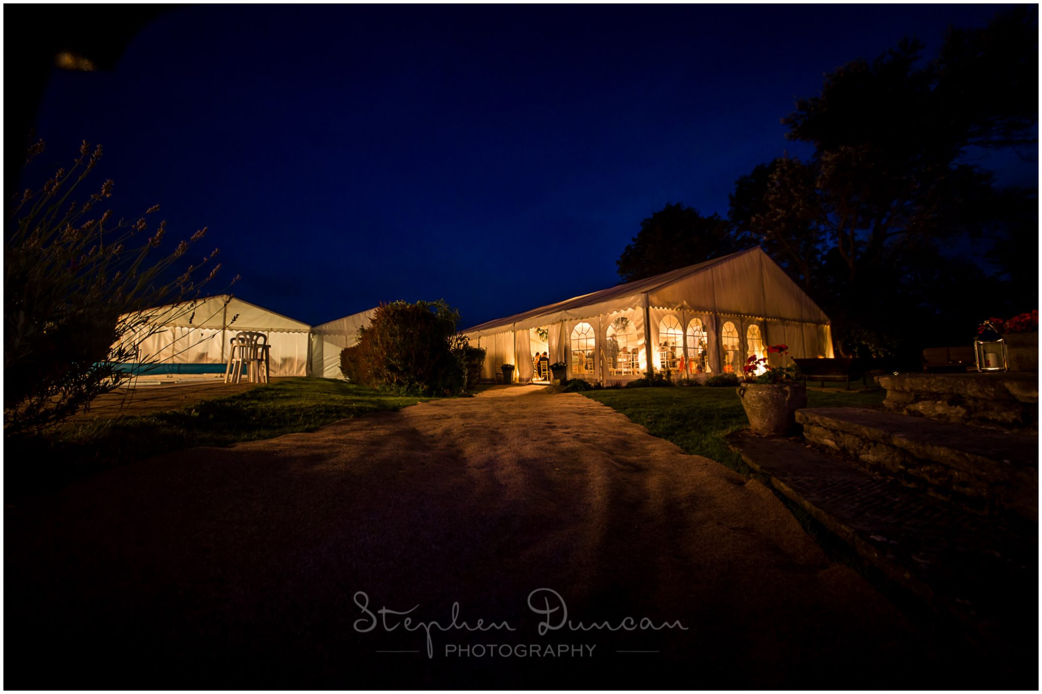 Lymington wedding photography marquee lit up at dusk