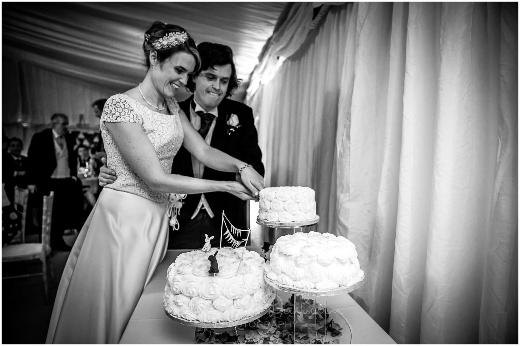 Lymington wedding photography cutting the cake