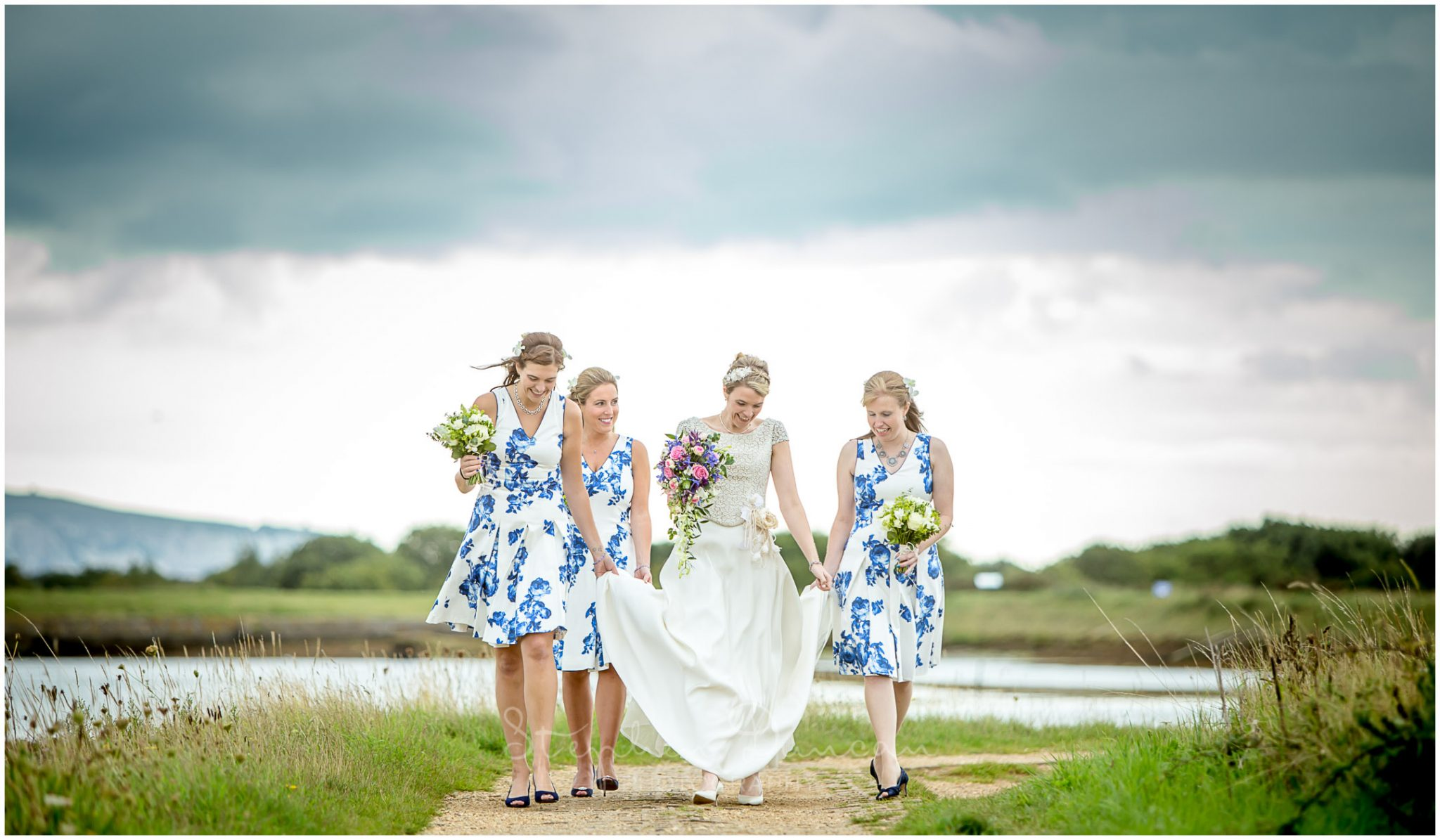 Lymington wedding photography bride walking with bridesmaids