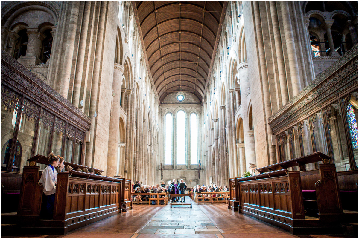Romsey Abbey wedding photographer church interior as guests arrive