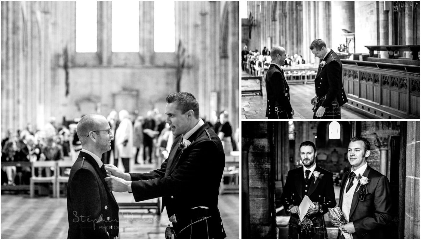 Romsey Abbey wedding photographer groom waits with best man