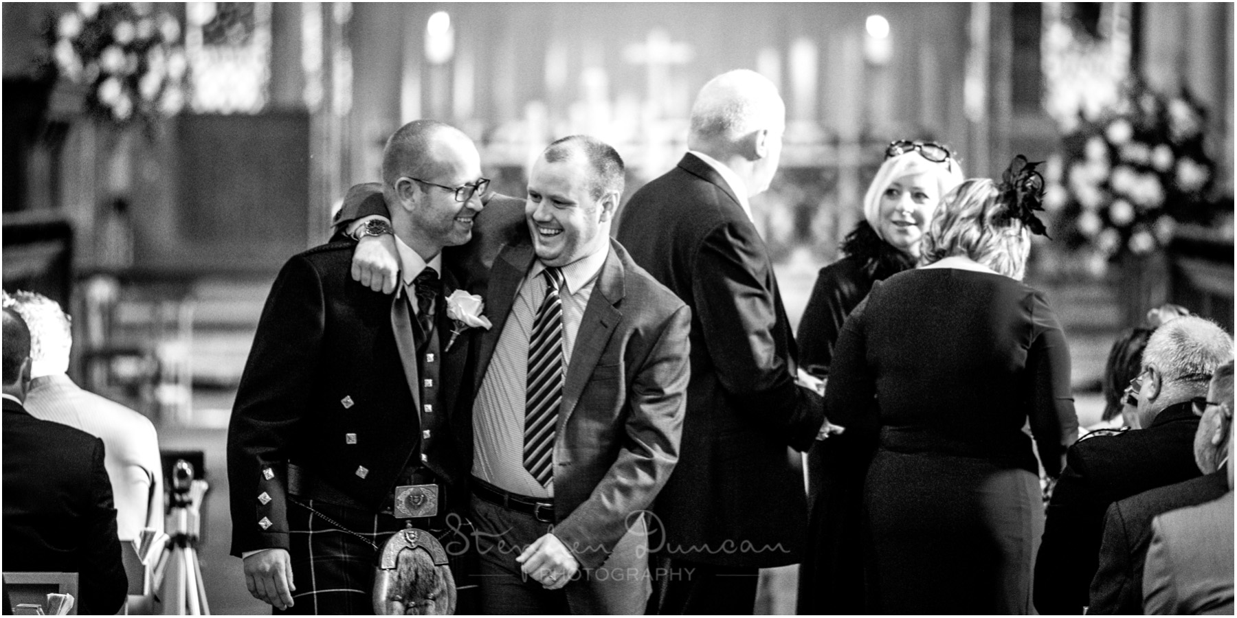 Romsey Abbey wedding photographer groom with guest