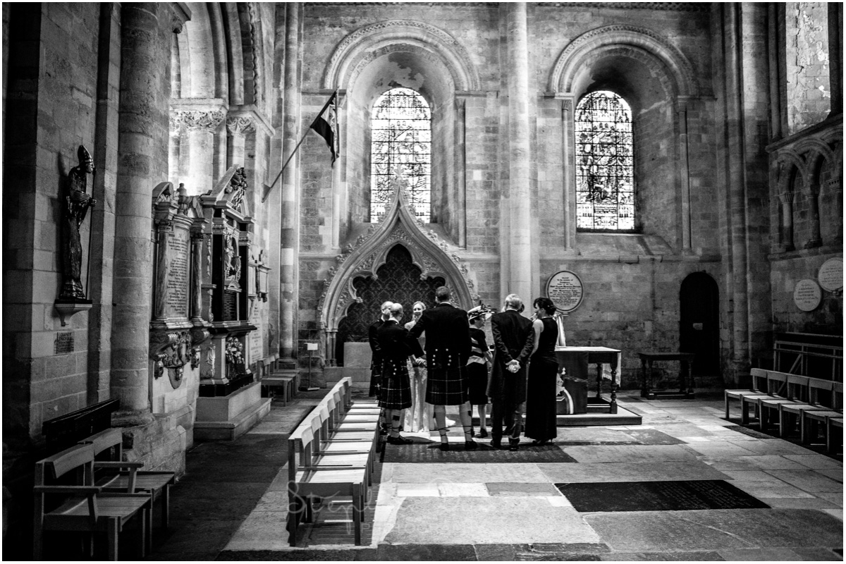 Romsey Abbey wedding photographer guests as register is signed