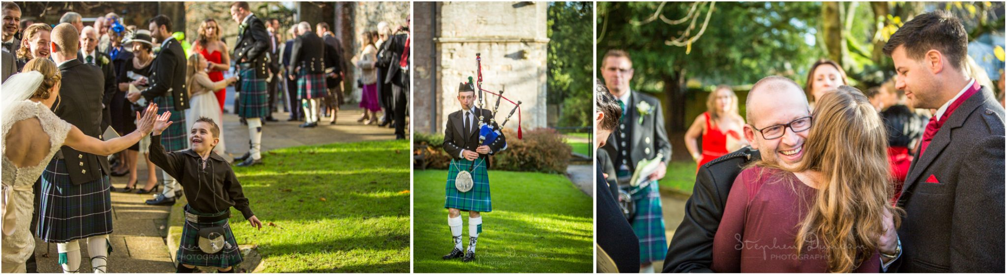 Romsey Abbey wedding photographer guests assemble in grounds of church with bagpiper