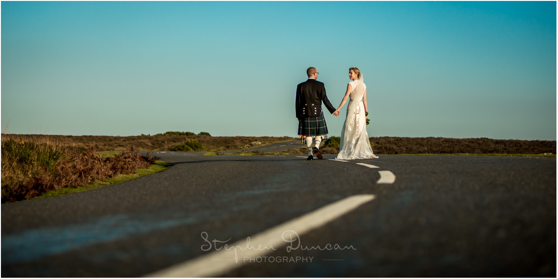 Romsey Abbey wedding photographer couple walk along new forest road