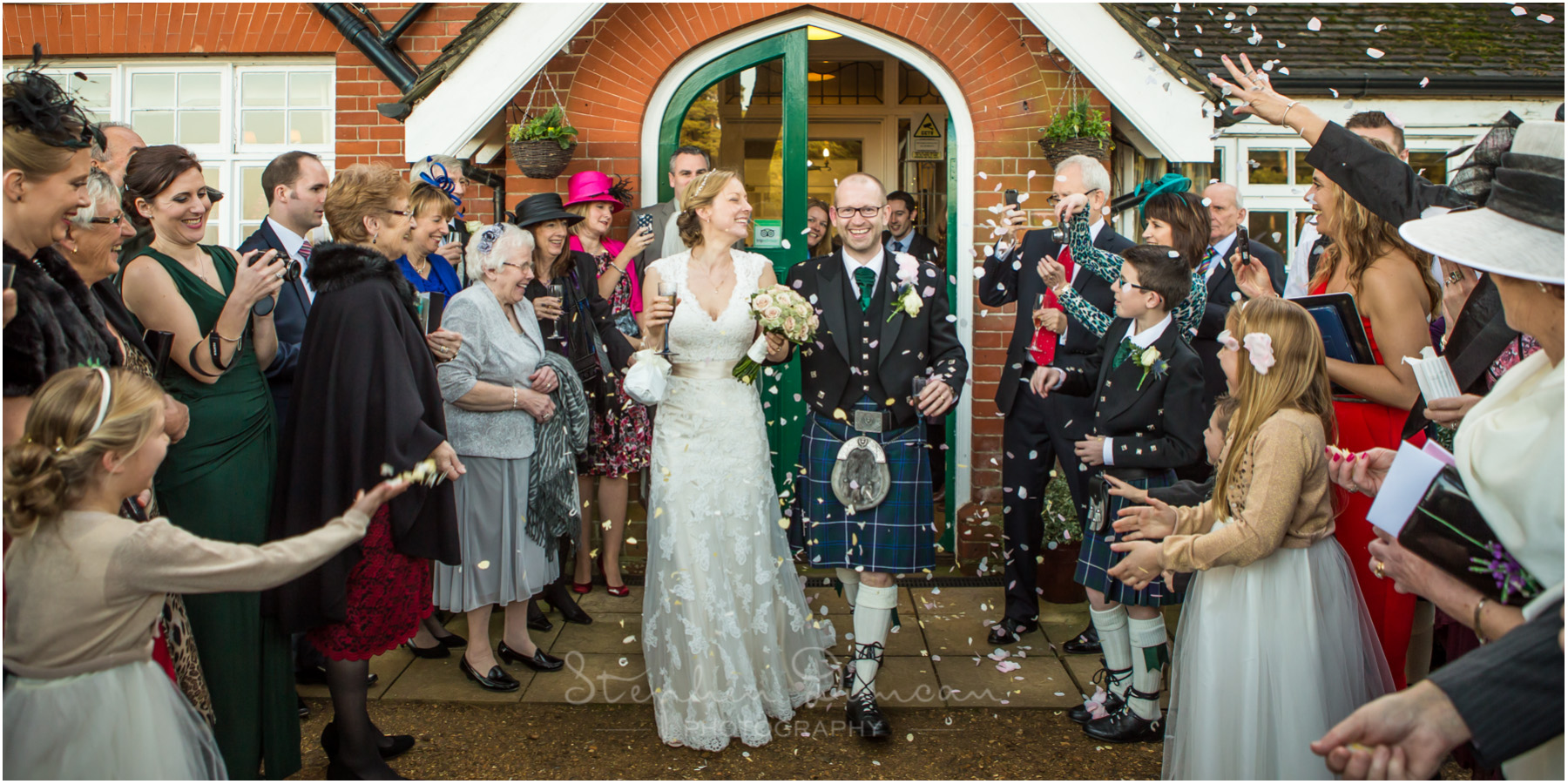 Romsey Abbey wedding photographer coupole greeted with confetti