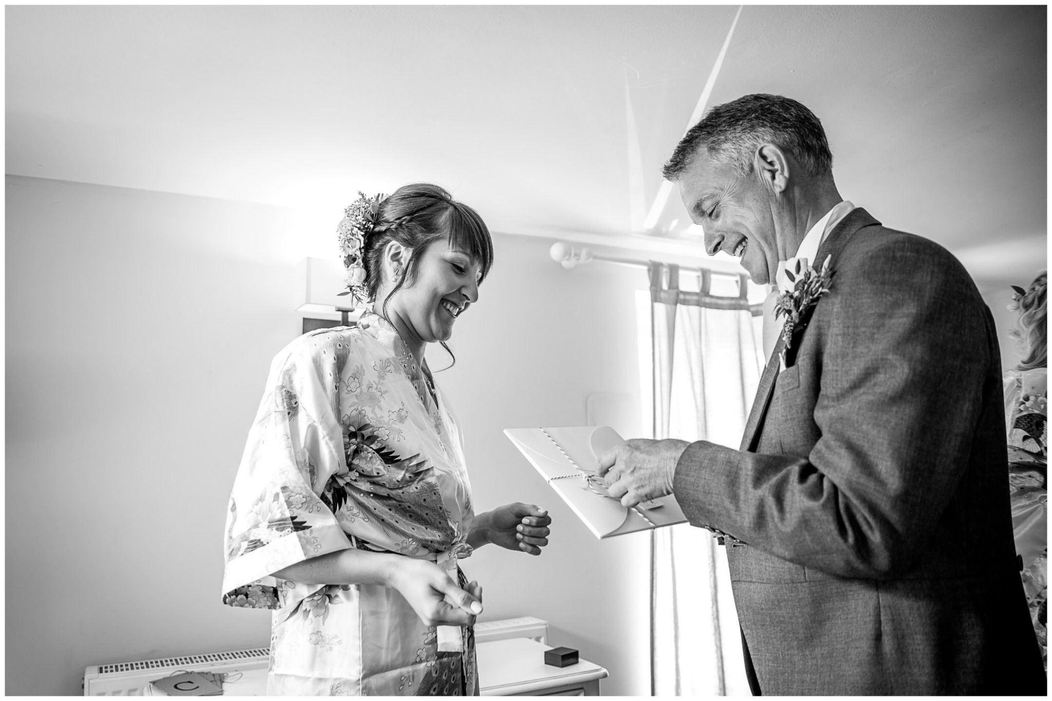Sopley Mill wedding photography bride gives gift to father in dressing room