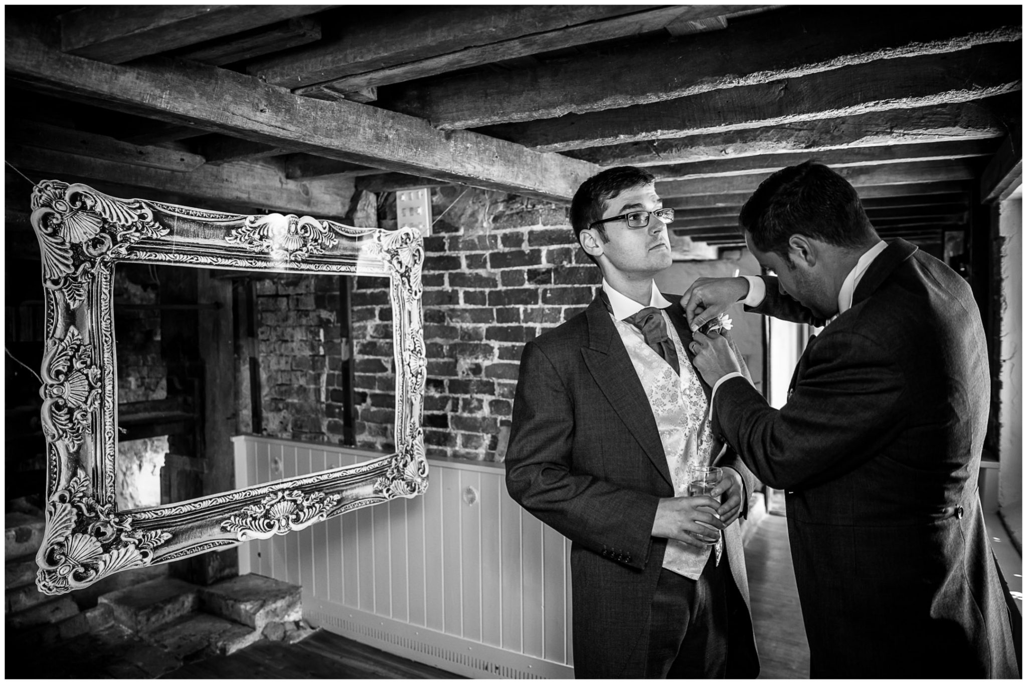 Sopley Mill wedding photography groom getting ready on ground floor