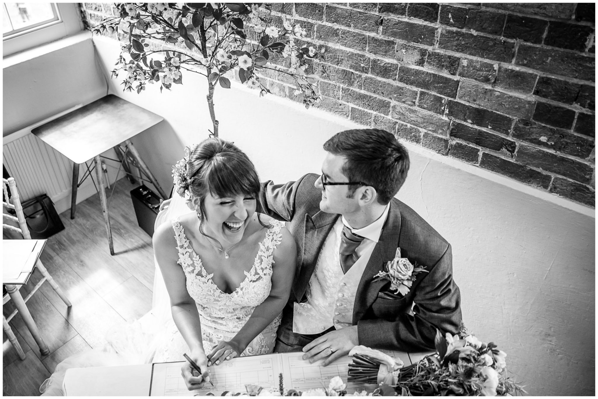 Sopley Mill wedding photography laughter signing register